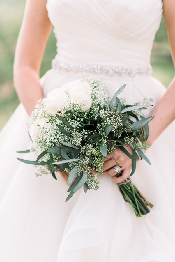 The Lodge at Ventana Canyon desert wedding photo of bride and white roses bouquet by Tucson Wedding Photographer | Bryan and Anh of West End Photography