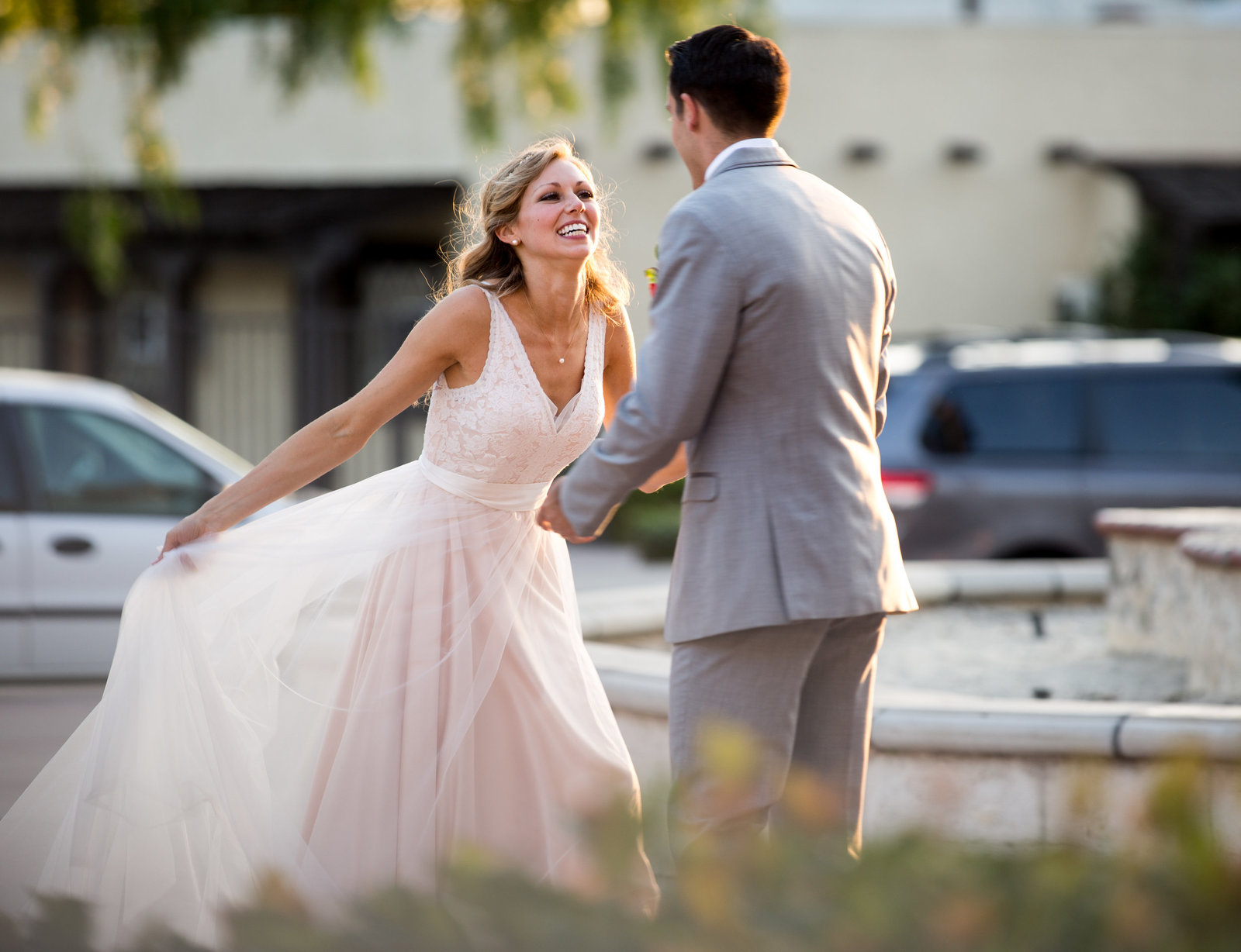 bride and groom dancing together at grapevine arbor in san gabriel