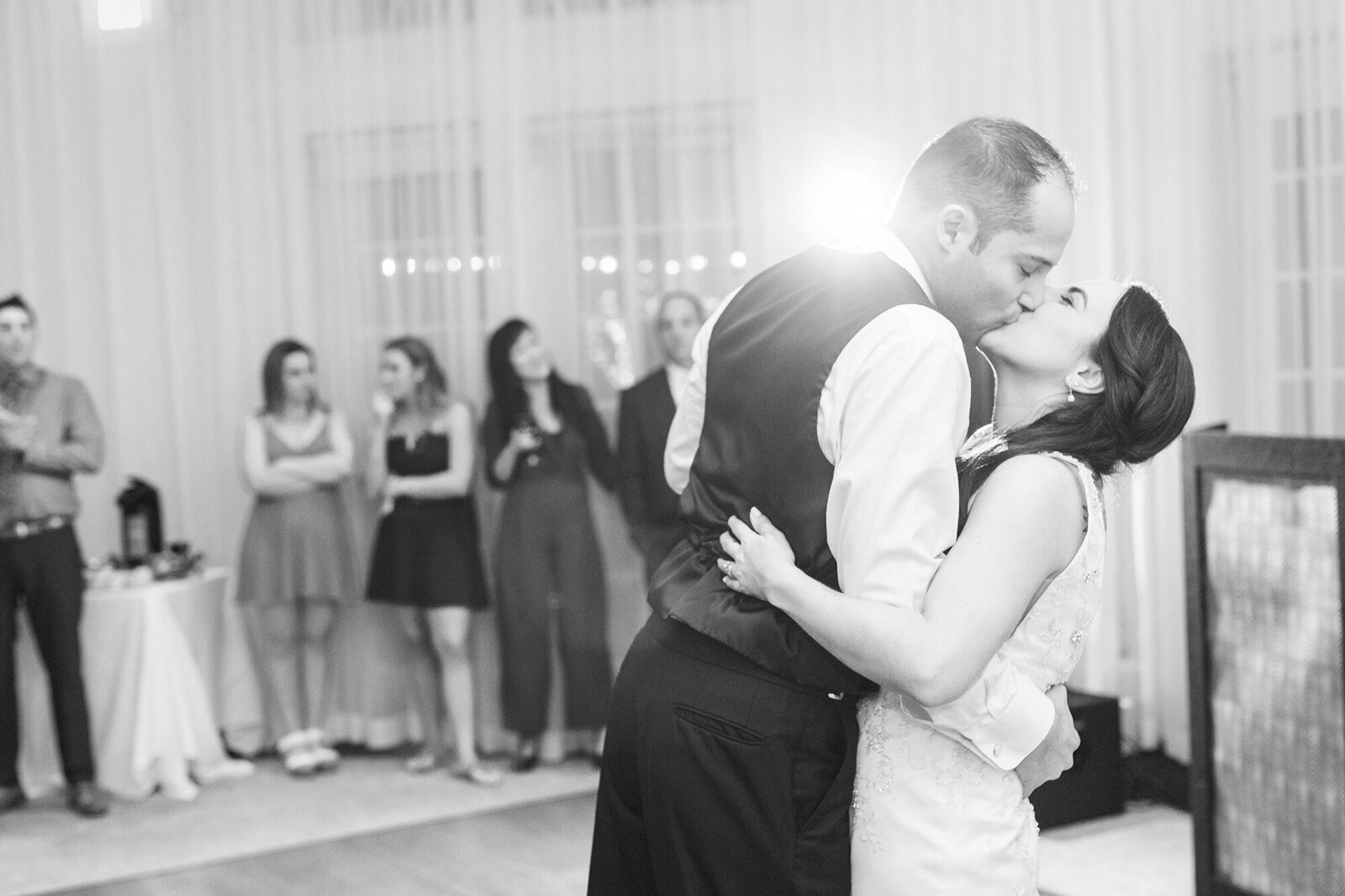 a bride and groom kiss while sharing their first dance at their vizcaya sacramento wedding.
