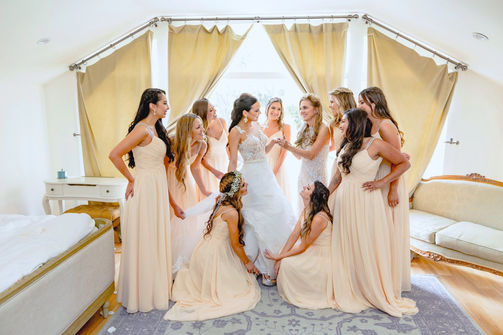 bride getting her final touches from bridesmaids at the newhall mansion