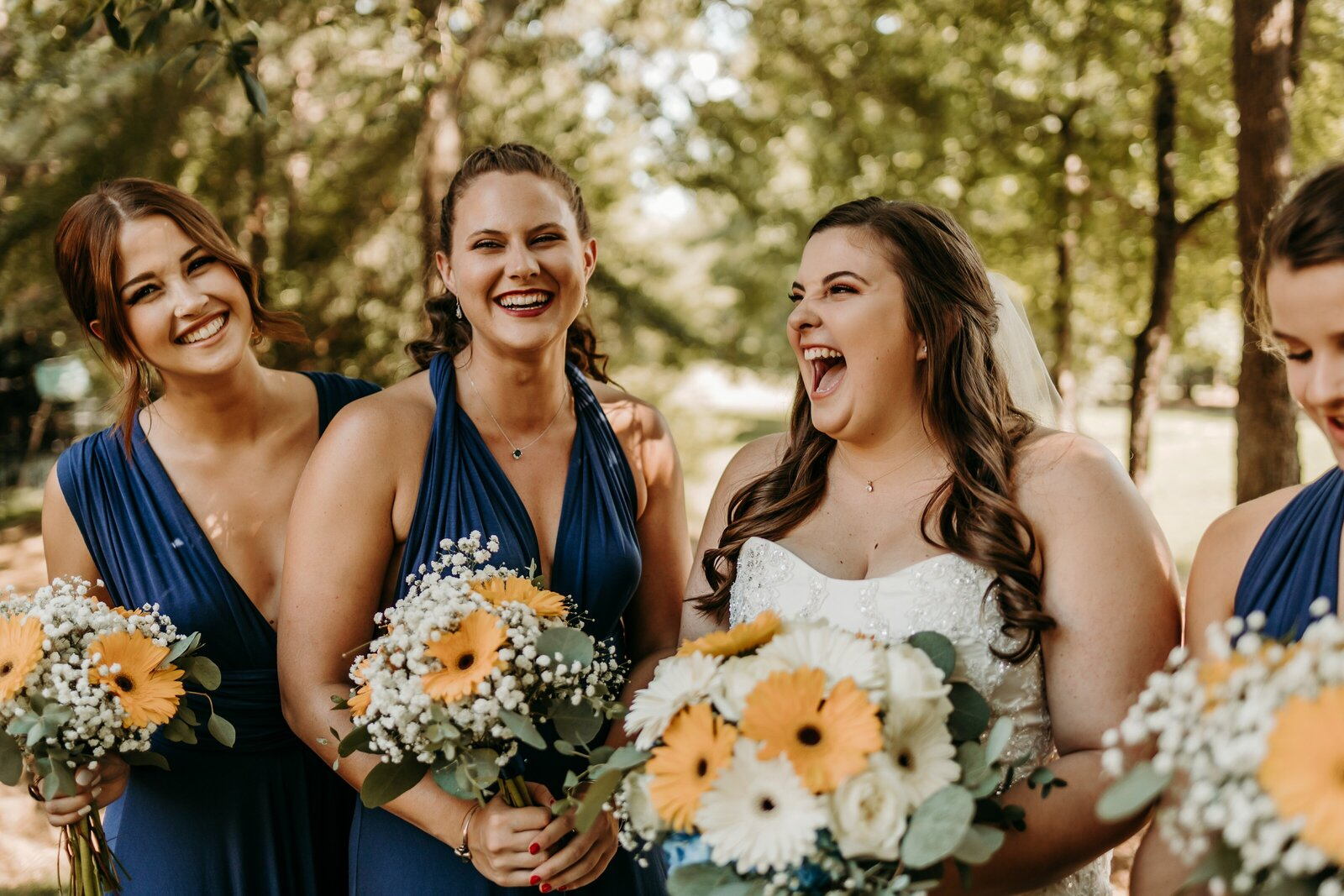 J.Michelle Photography photographs bride and bridesmaids laughing