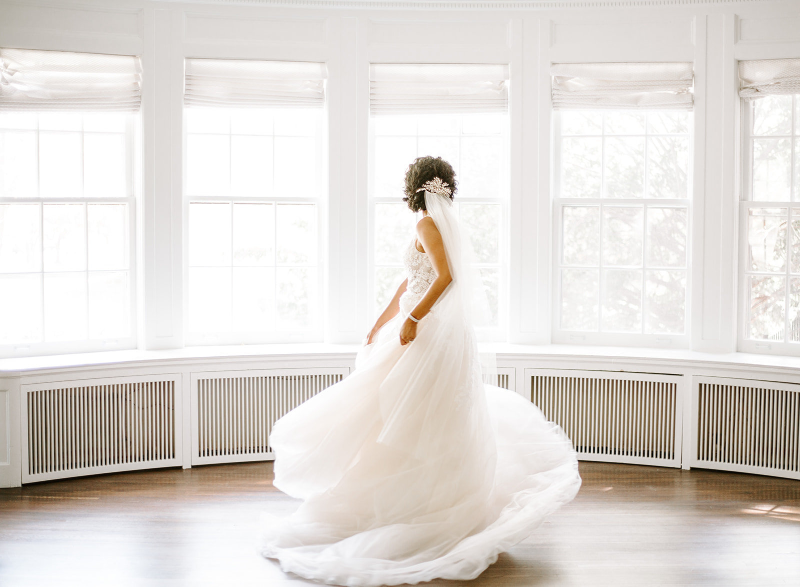 Bride twirling in her wedding dress during her Minneapolis wedding day