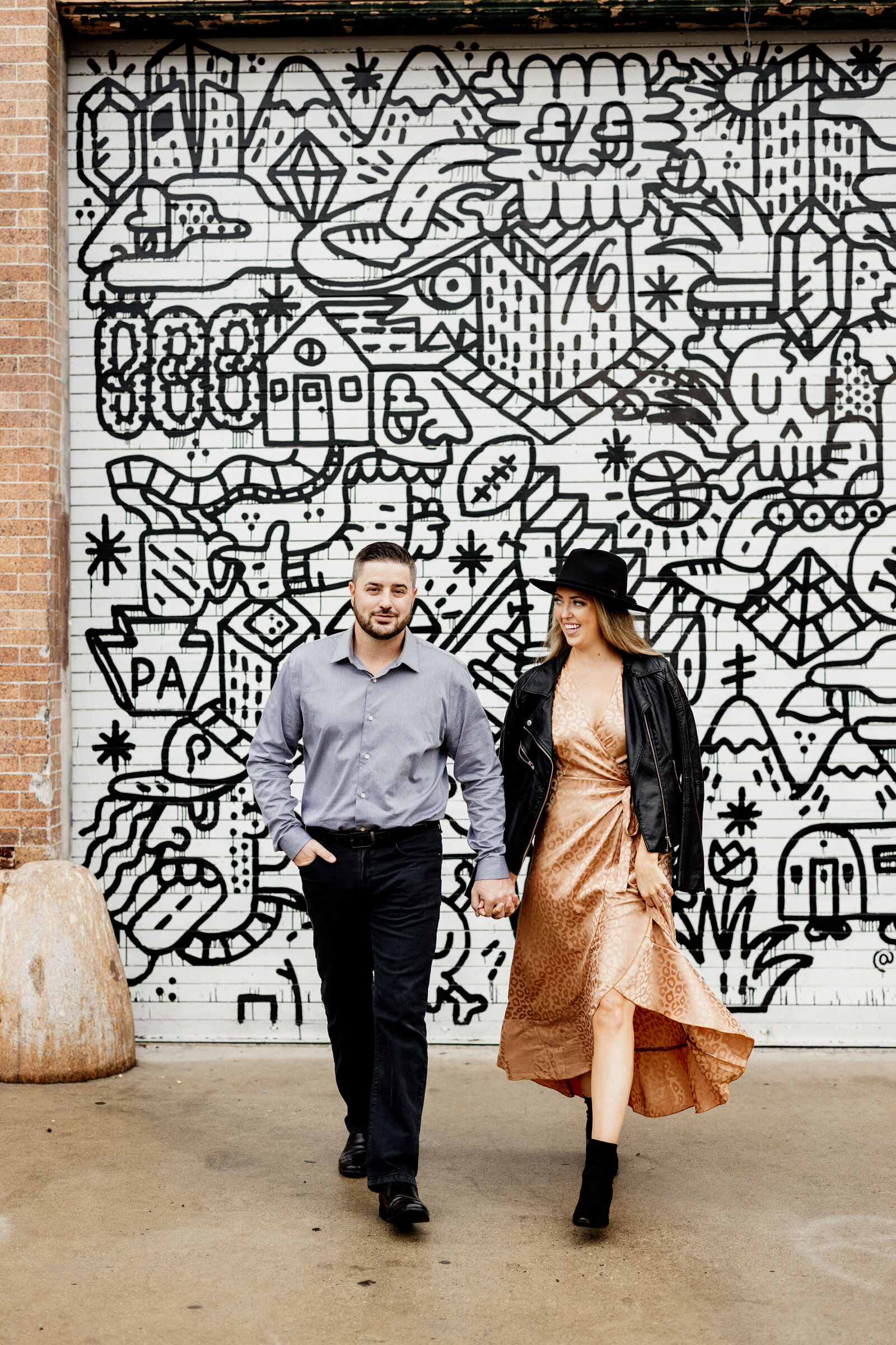couple at colorful city mural