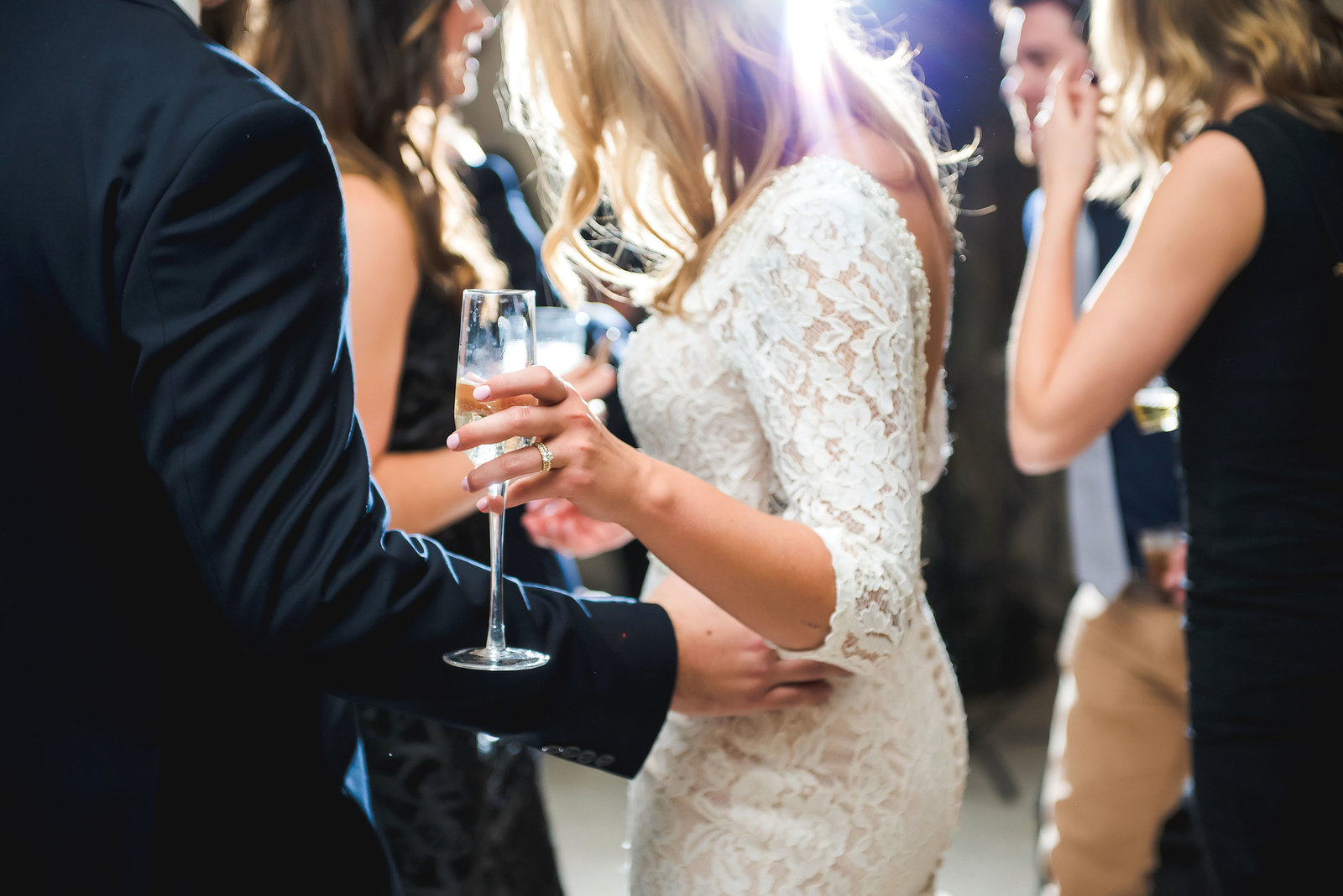 Photo of a bride dancing with a glass of champagne at a wedding at Belle Isle Casino