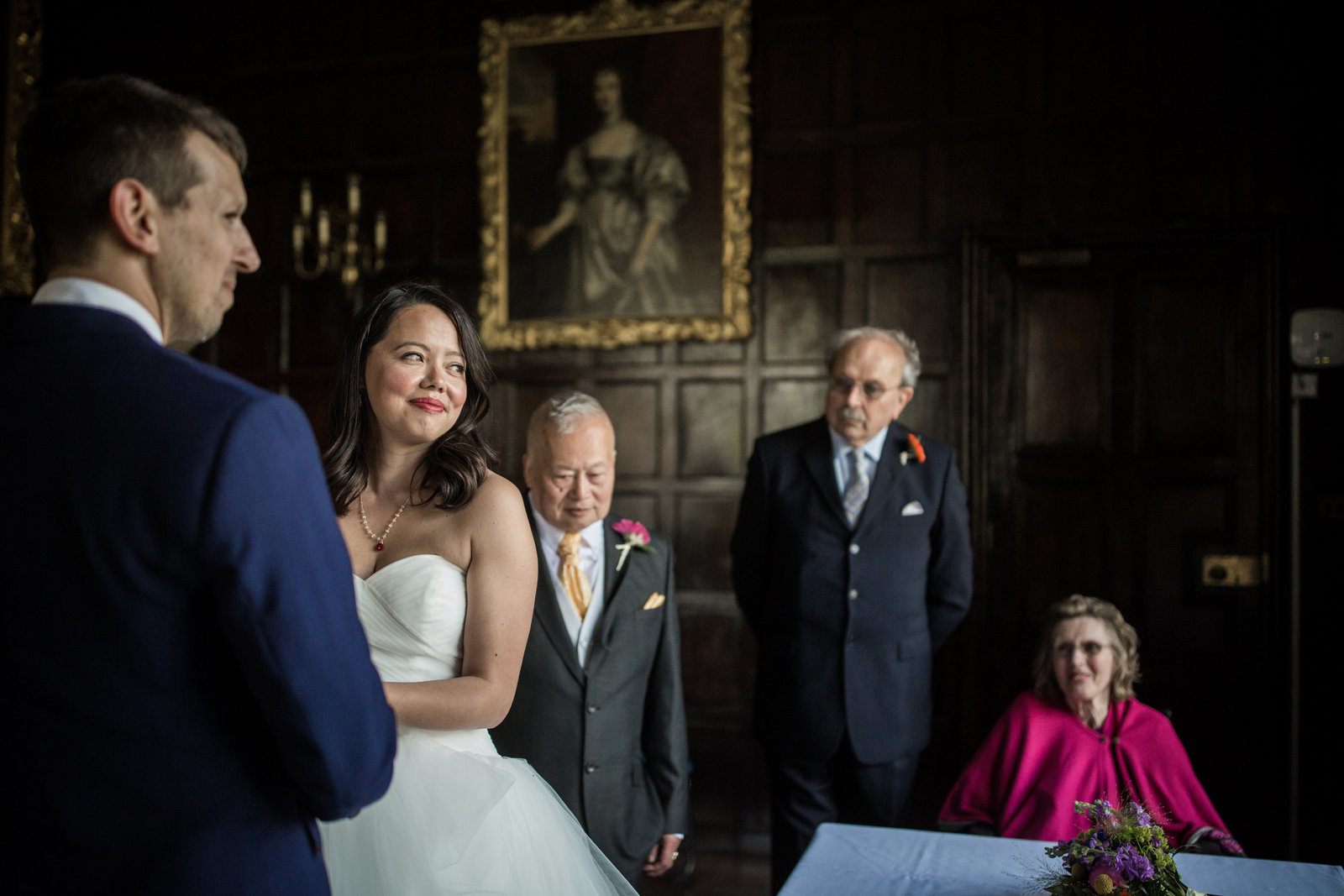 Bride and Groom marry in front of the registrar in a stately home in Norfolk whilst their elderly parents look on.