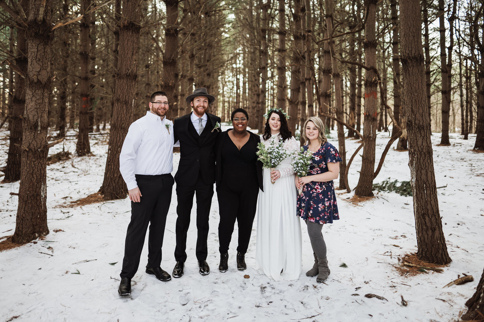 Hey Tay takes photo with couple in burr oaks wood elopement