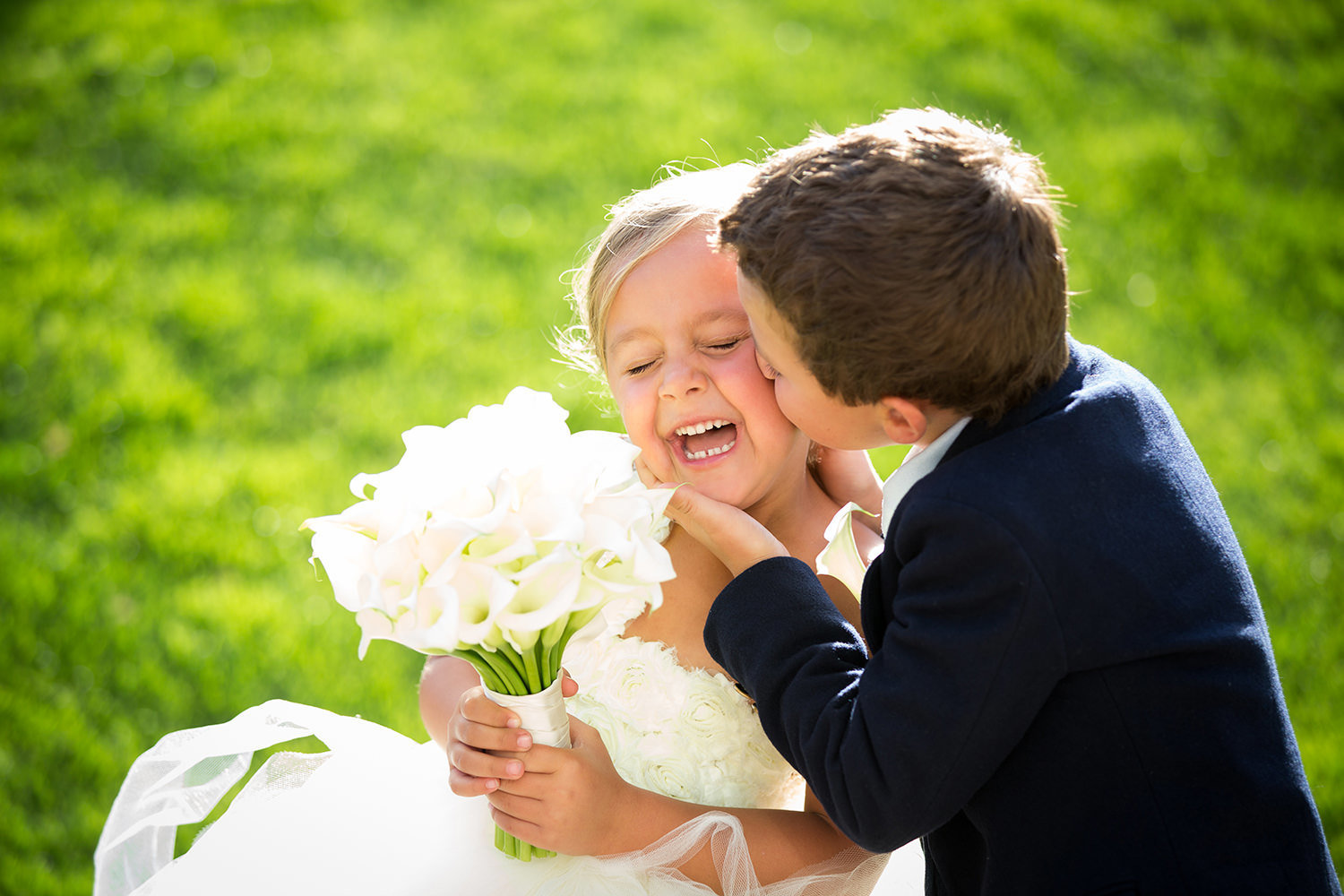 Sweet moment between the flower girl and ring bearer