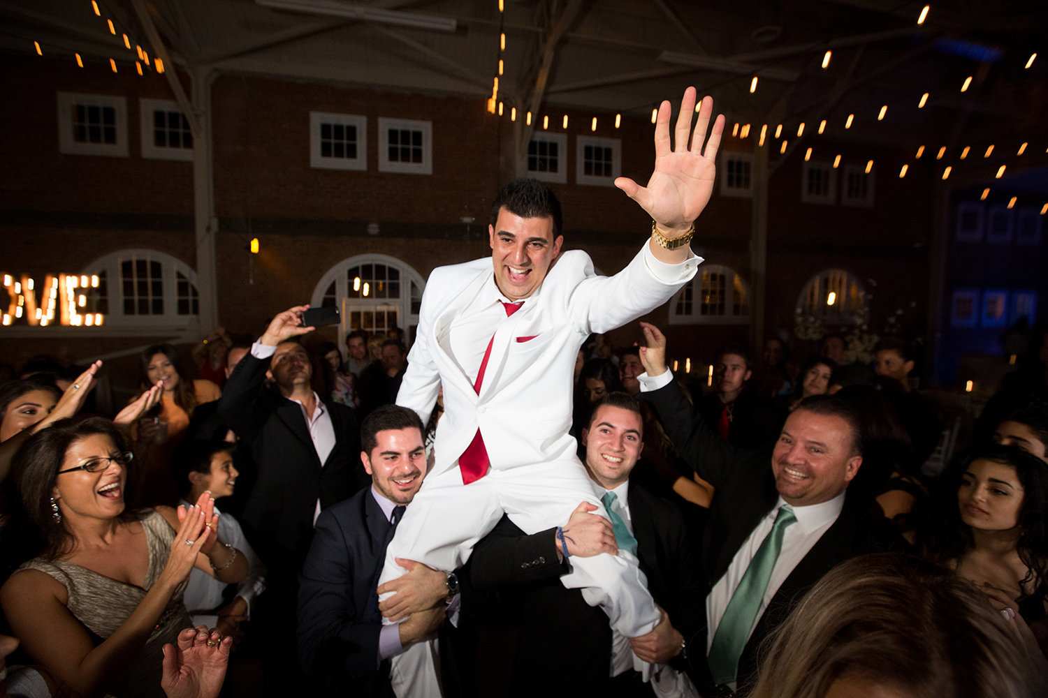 Groom flying high at the wedding reception