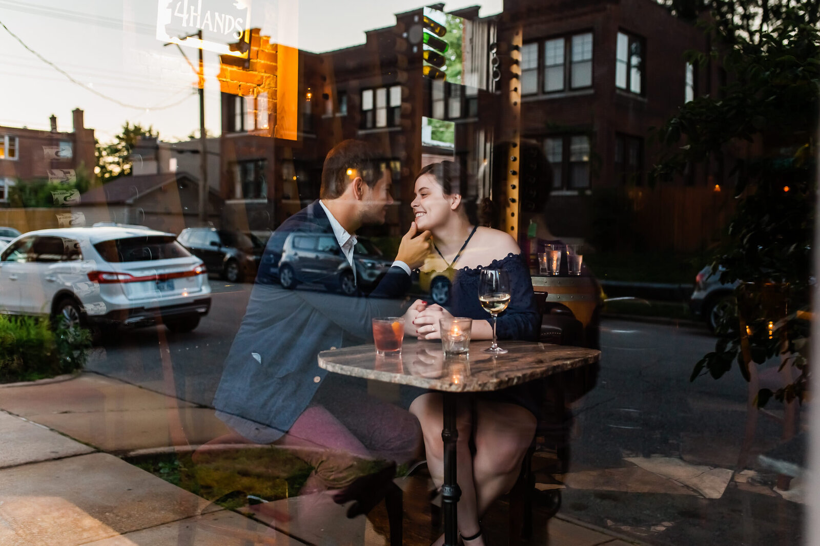 Romantic engagement photo of a couple having drinks at Sasha's bar in St. Louis