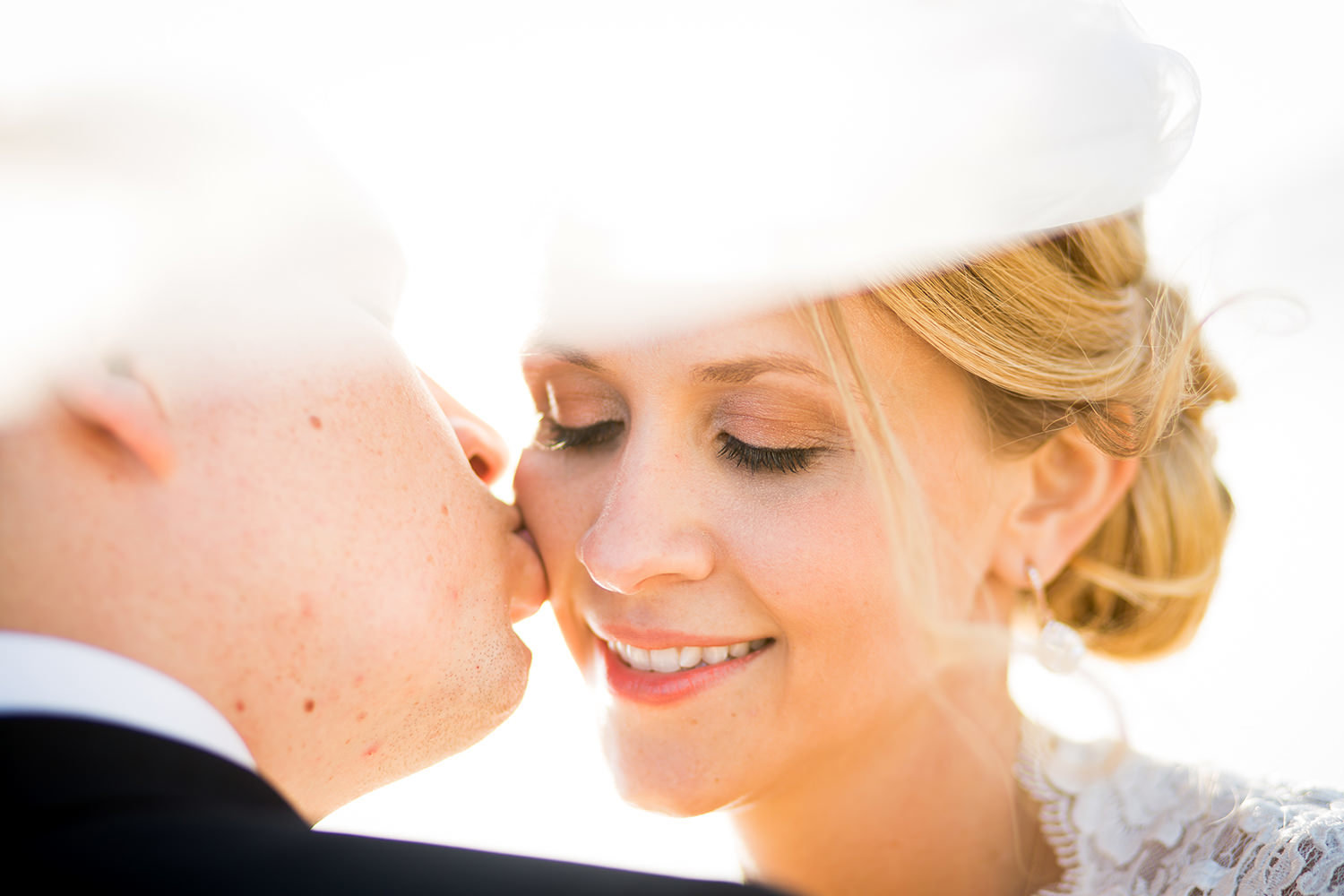 closeup of groom kissing bride