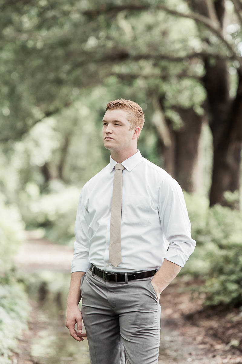Groom poses under trees, Hampton Park, Charleston Wedding Photography