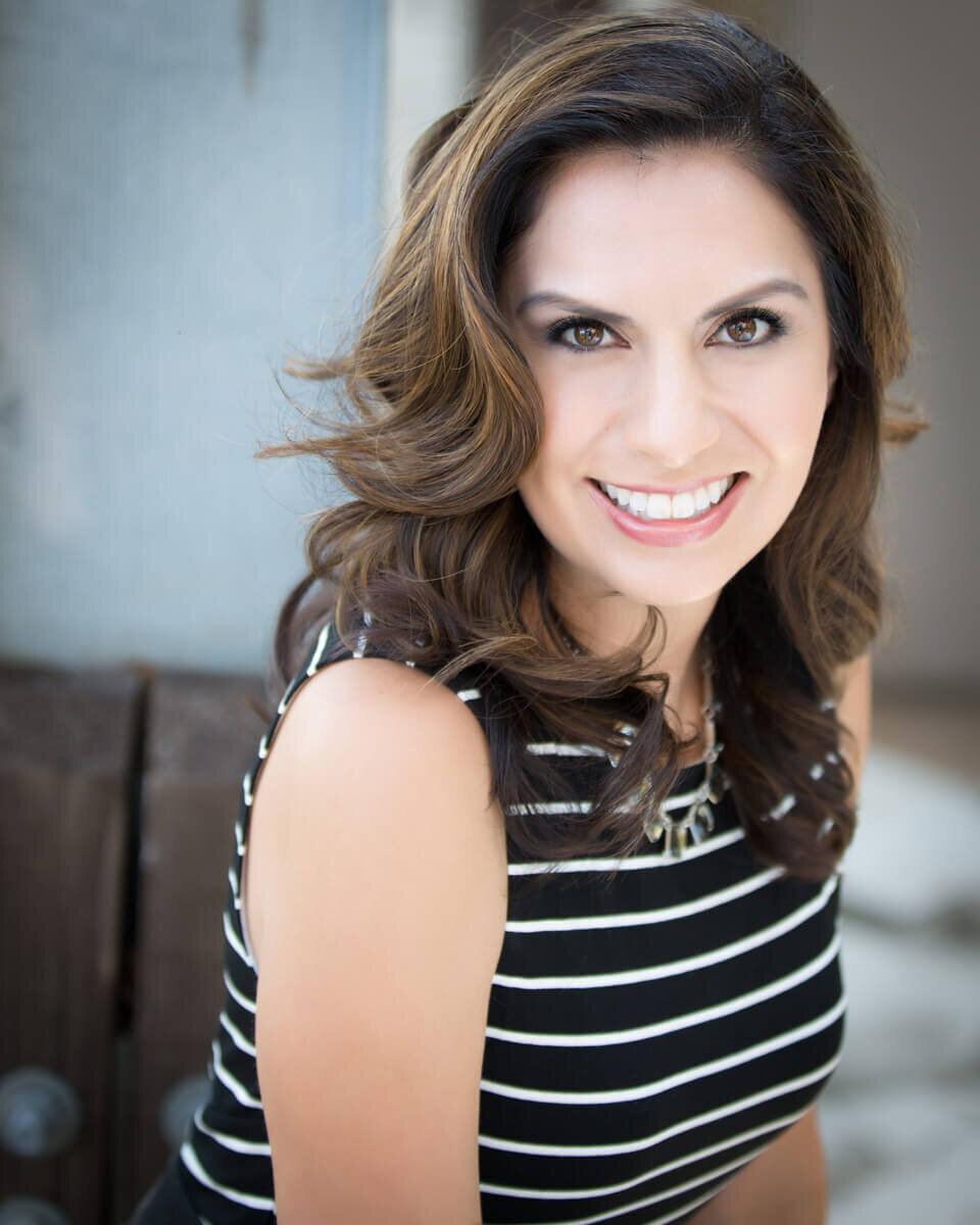 Woman smiling at the camera for brightly lit professional headshot in Austin TX