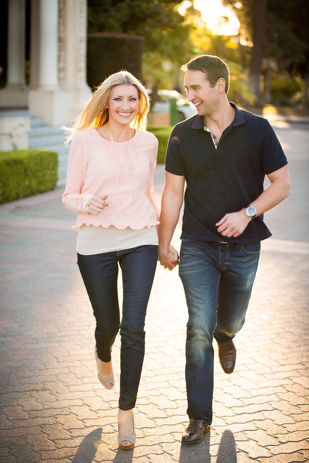 Balboa Park engagement photos fun couple running holding hands