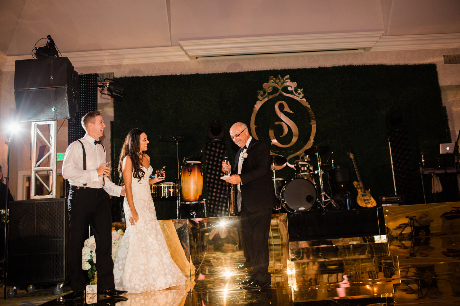 father of the bride toast on a gold mirrored dance floor