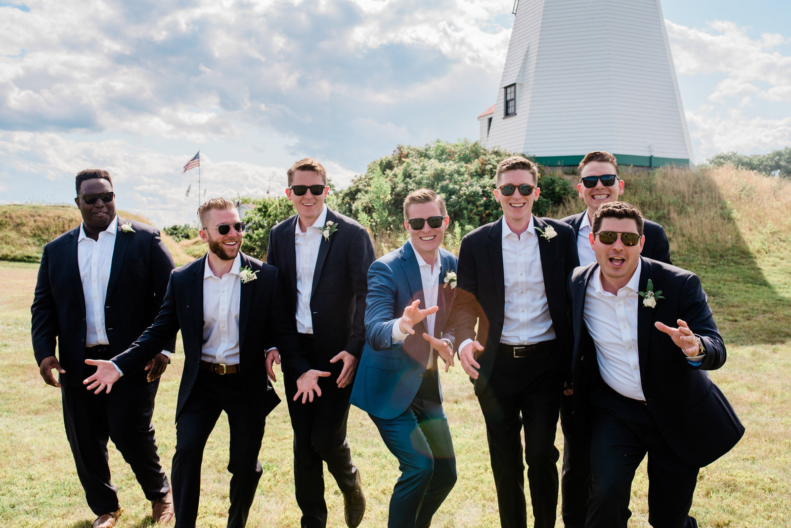 A shot of the groomsmen at the Gurnet point lighthouse at a Duxbury wedding on the Gurnet