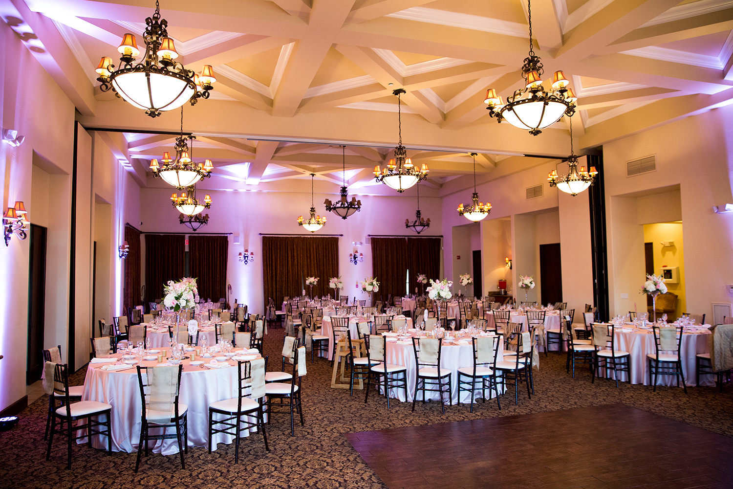 reception space at wedgewood purple uplighting