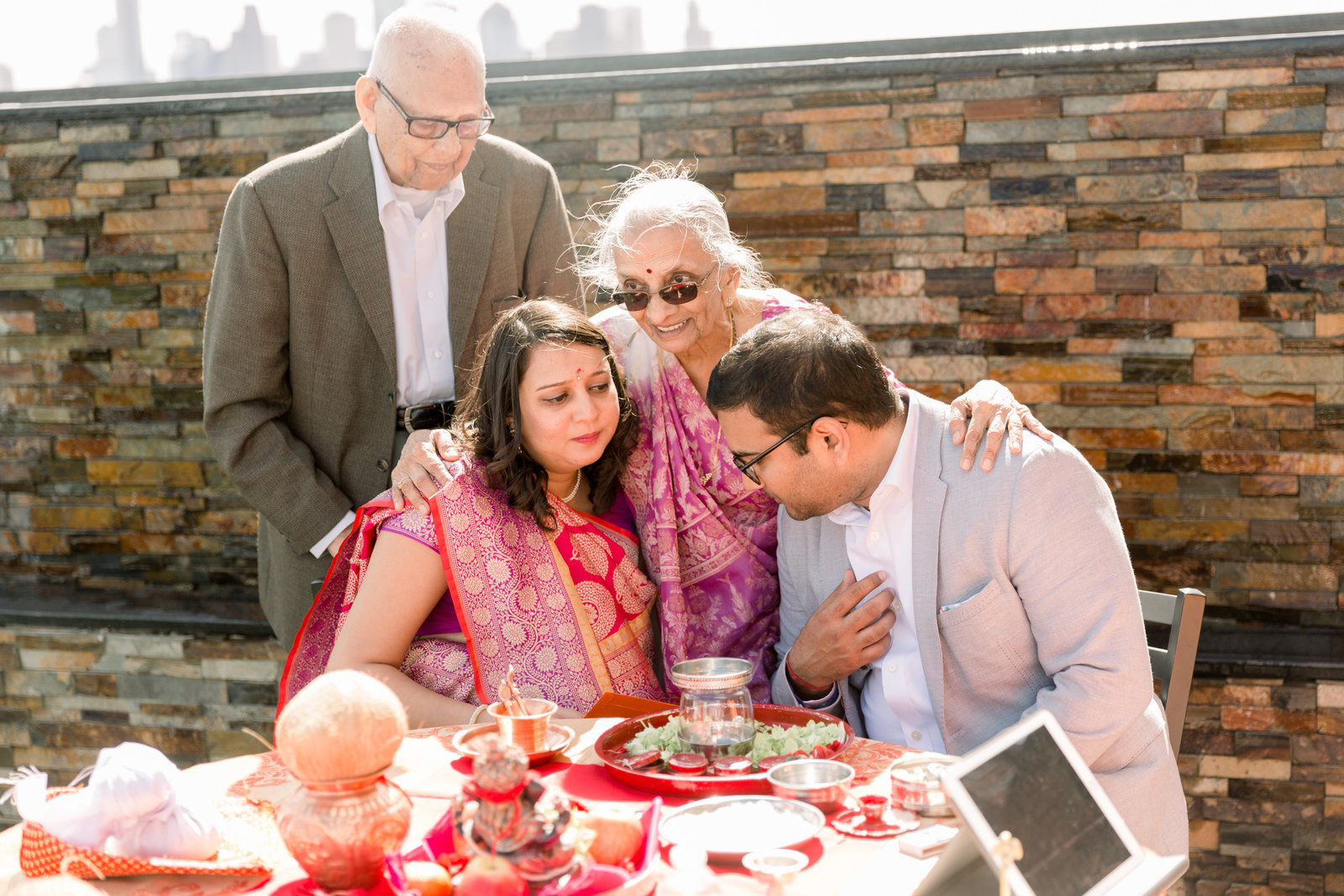 grandmother gives a blessing to parents to be at Hindu baby shower ceremony