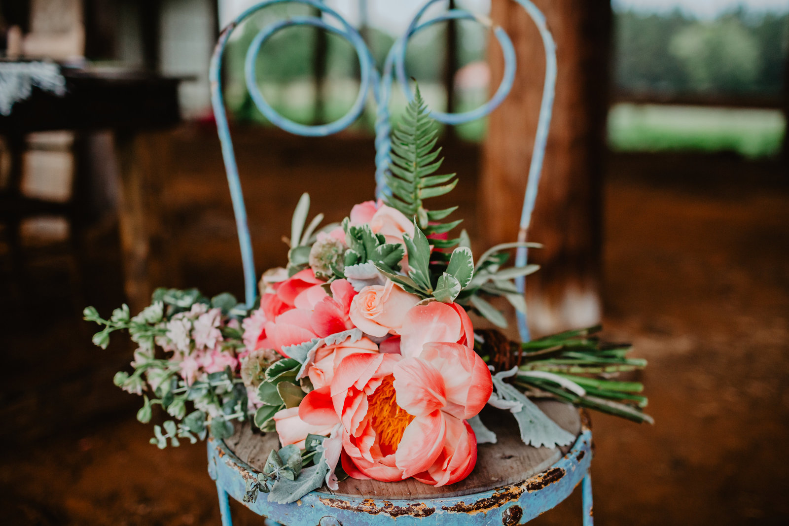 Placed upon a blue vintage iron chair this lush bridal bouquet was perfect in color and design