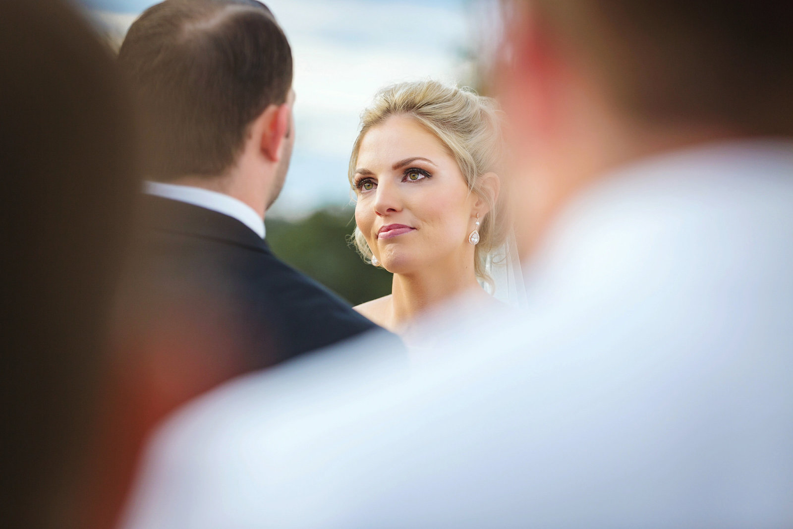 Bride looks into grooms eyes during wedding ceremony