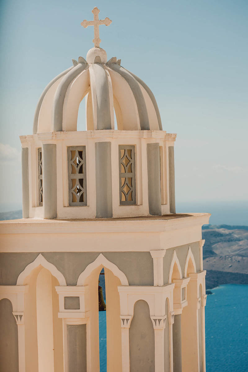 Grey and white Bell Tower in Fira, Santorini Island, Greece