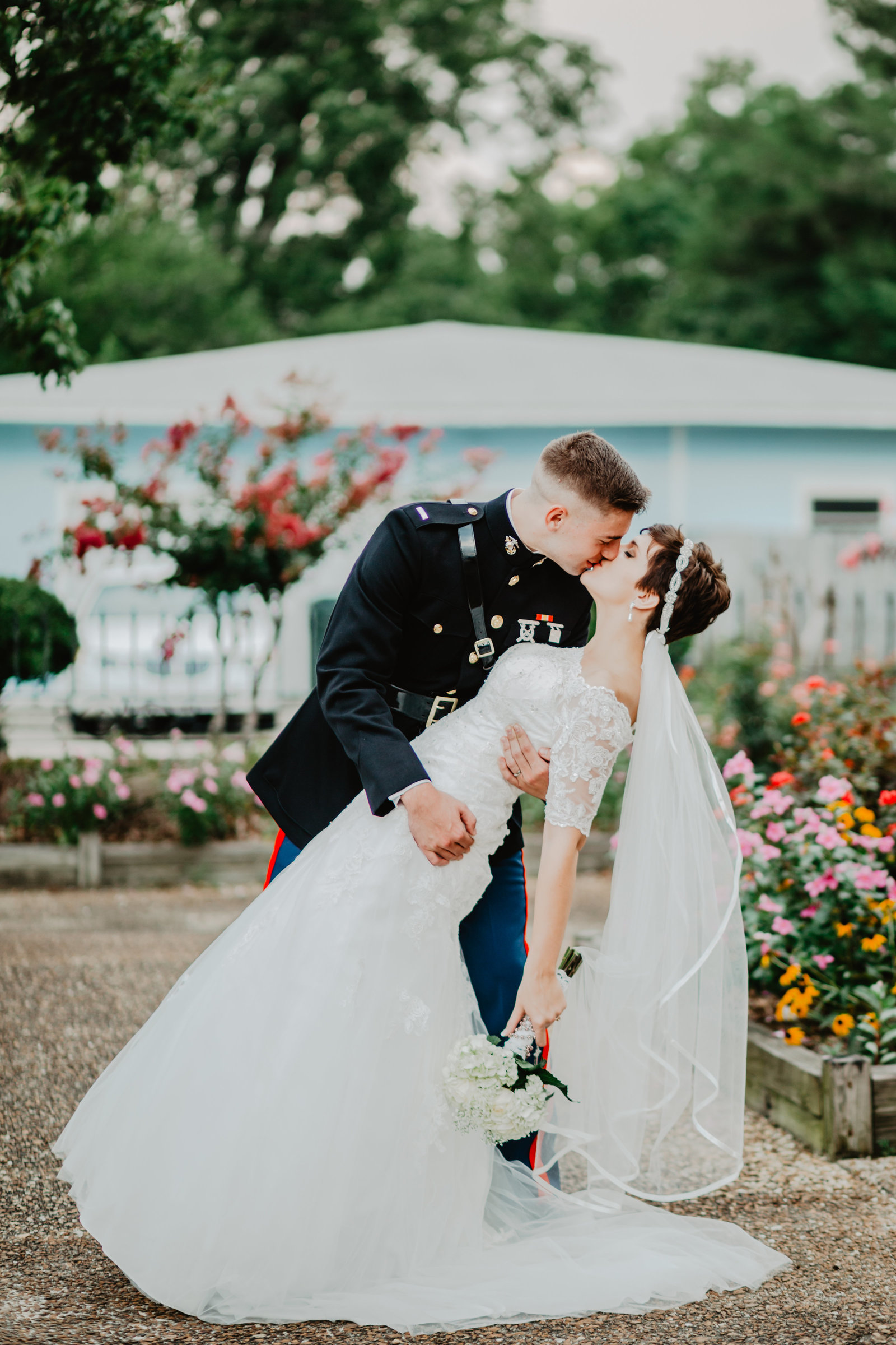 In military uniform Groom dips his Bride for a kiss.