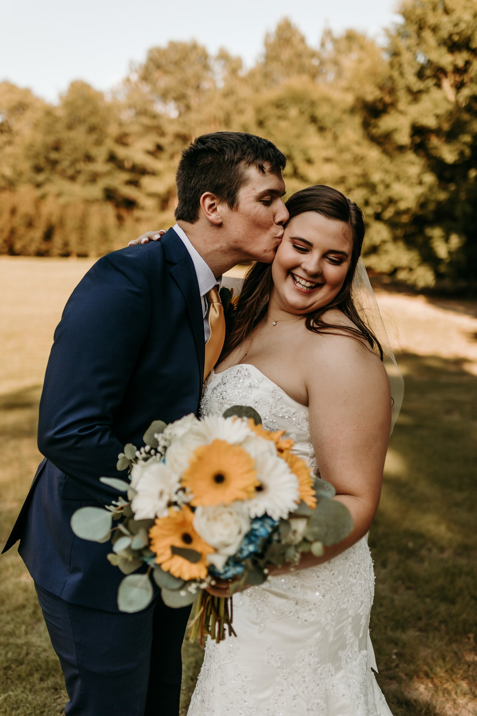 J.Michelle Photography photographs bride and groom kissing portrait