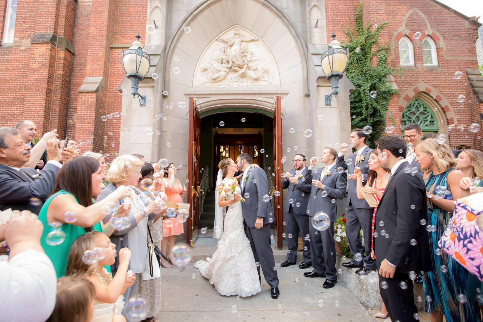 Romantic wedding ceremony church exit with bubbles