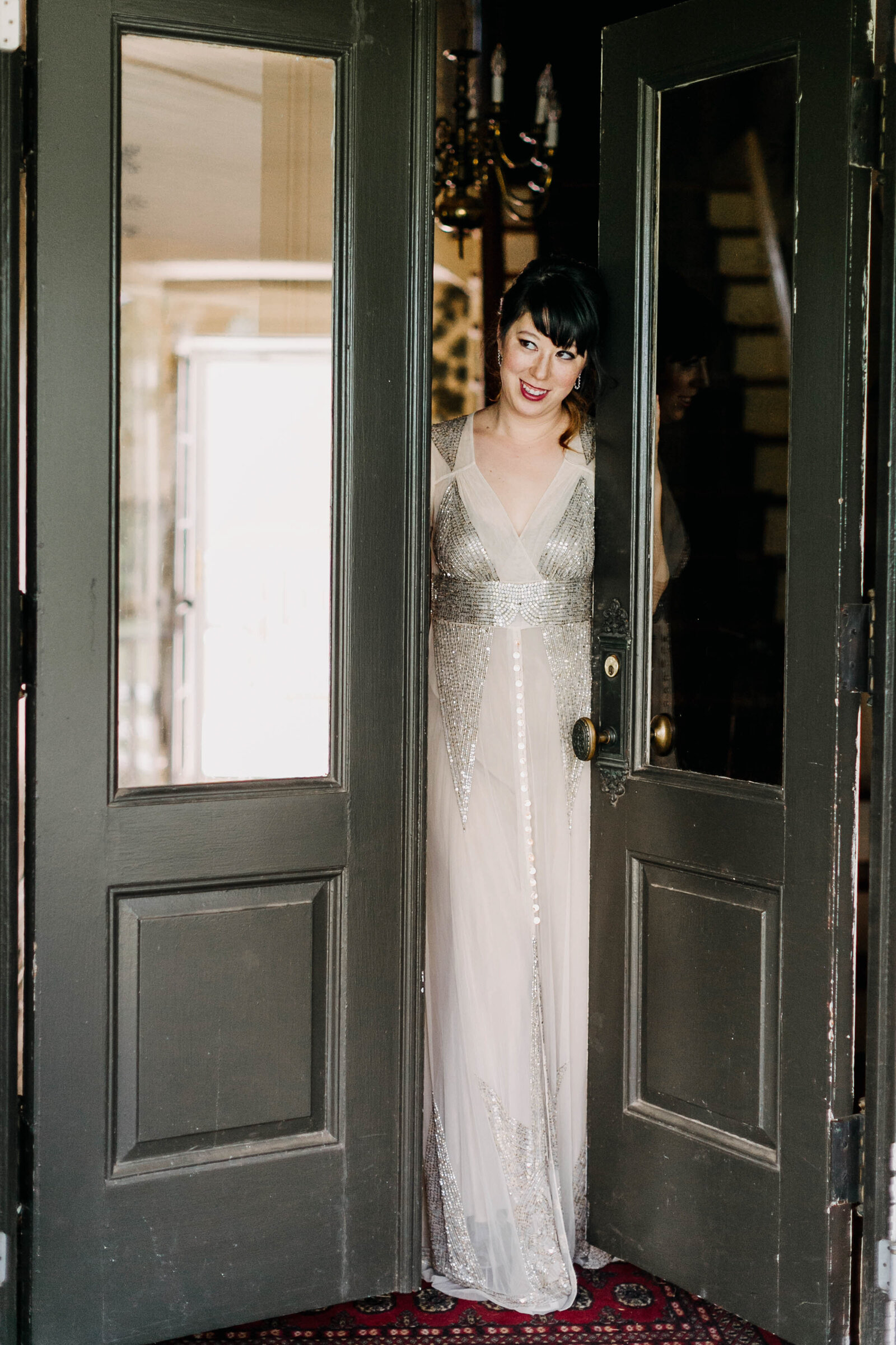 bride with sequins dress at vintage doors