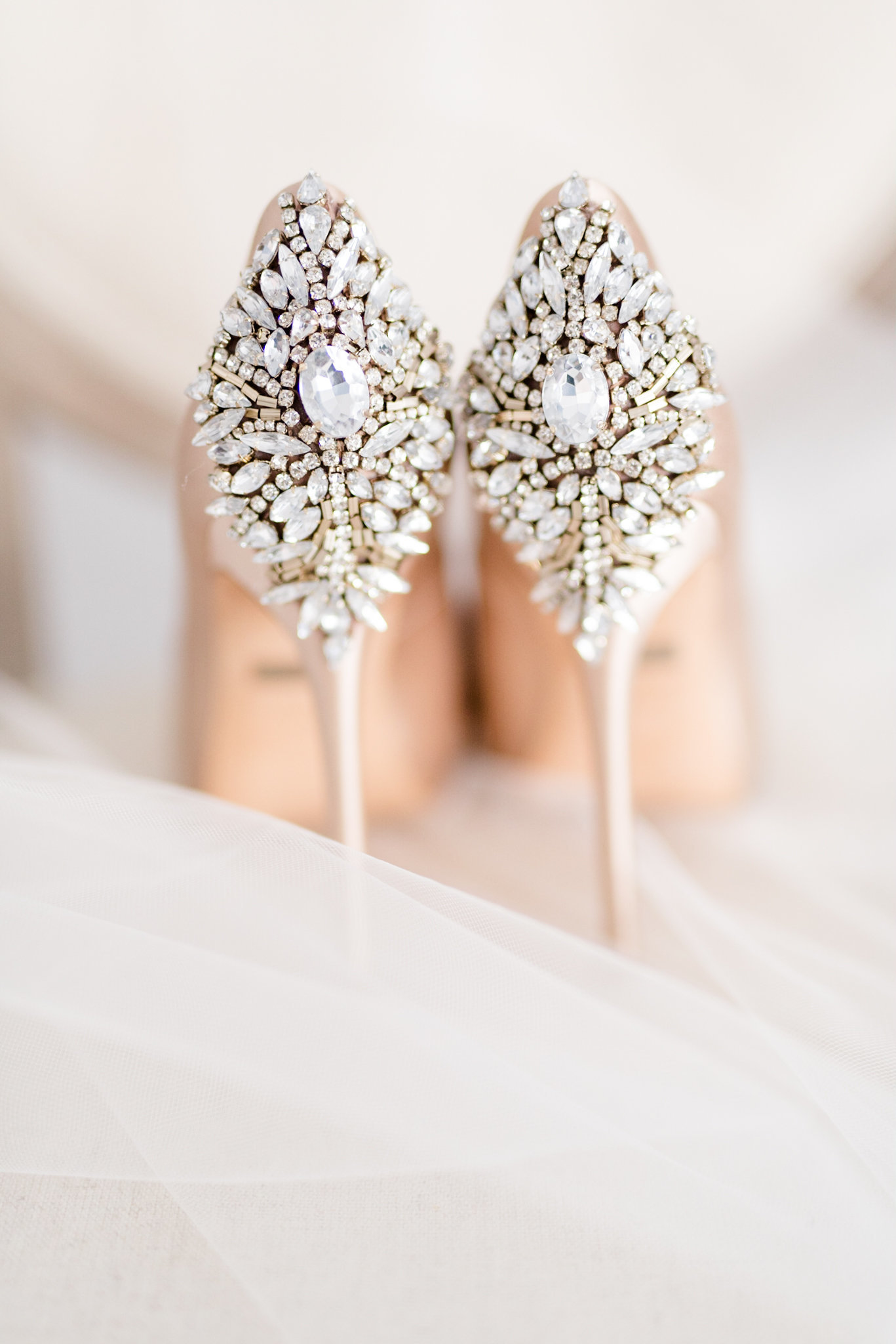Jeweled Wedding Heels sit on chair.