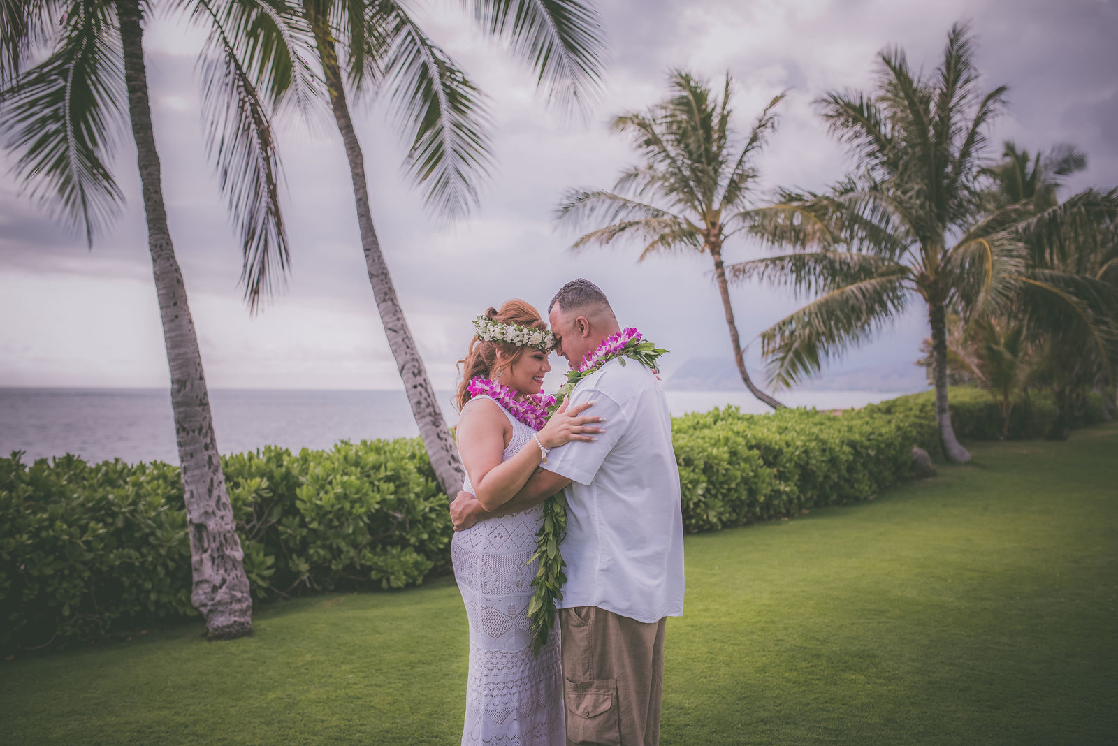 A couple goes forehead to forehead during their Paradise Cove Oahu elopement.
