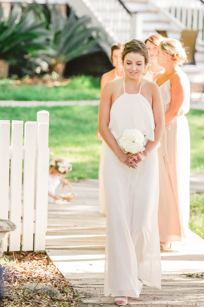 Bridesmaid walks down the aisle, I'ON Creek Club, Mt Pleasant, South Carolina. Kate Timbers Photography.