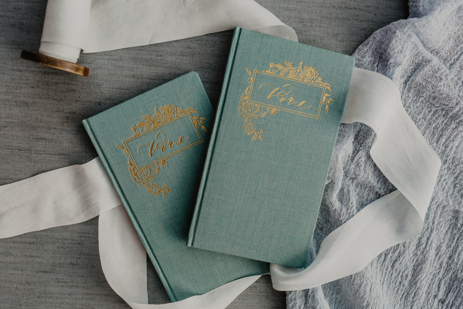 With the a soft mint green, these vow books make for a welcome addition to any cermony