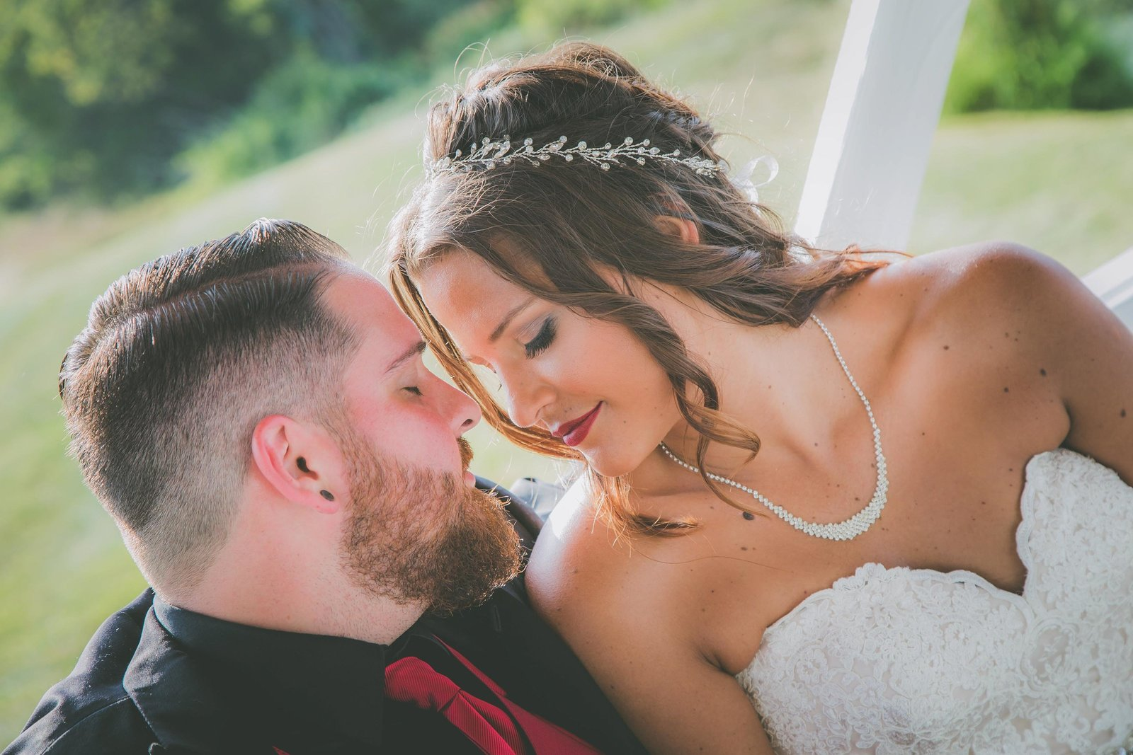 Couple closes their eyes and touch foreheads.