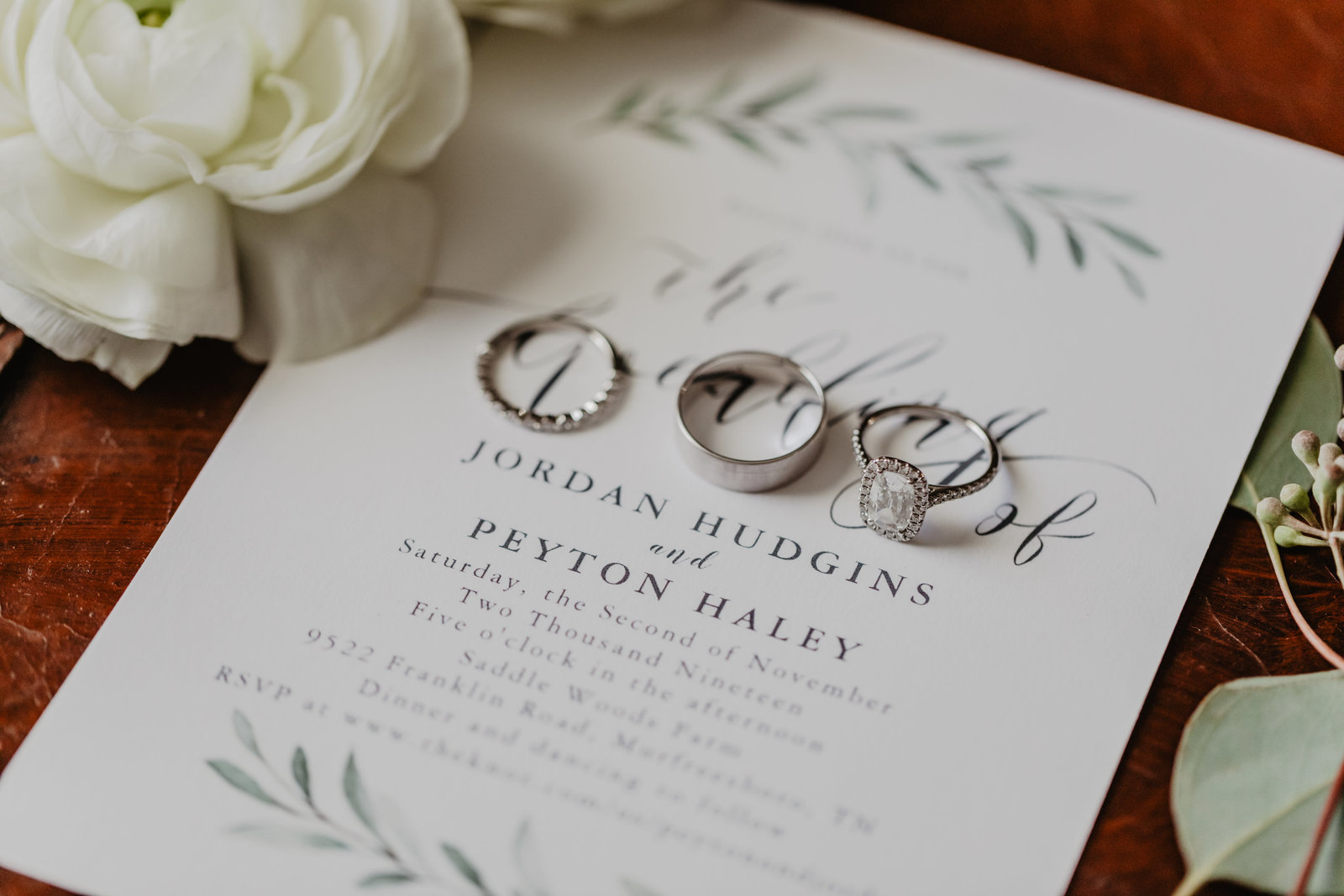 Wedding invitation with wedding bands at Saddle Woods Farm