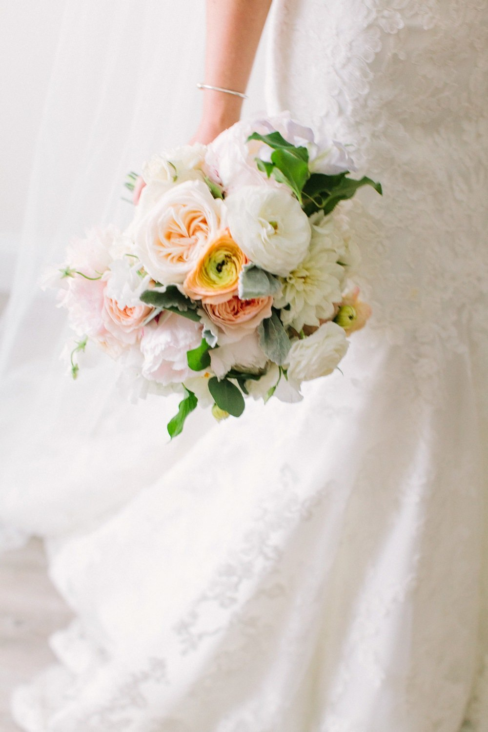 Gorgeous spring bridal bouquet in ivory, yellow and blush for Belle Mer Wedding