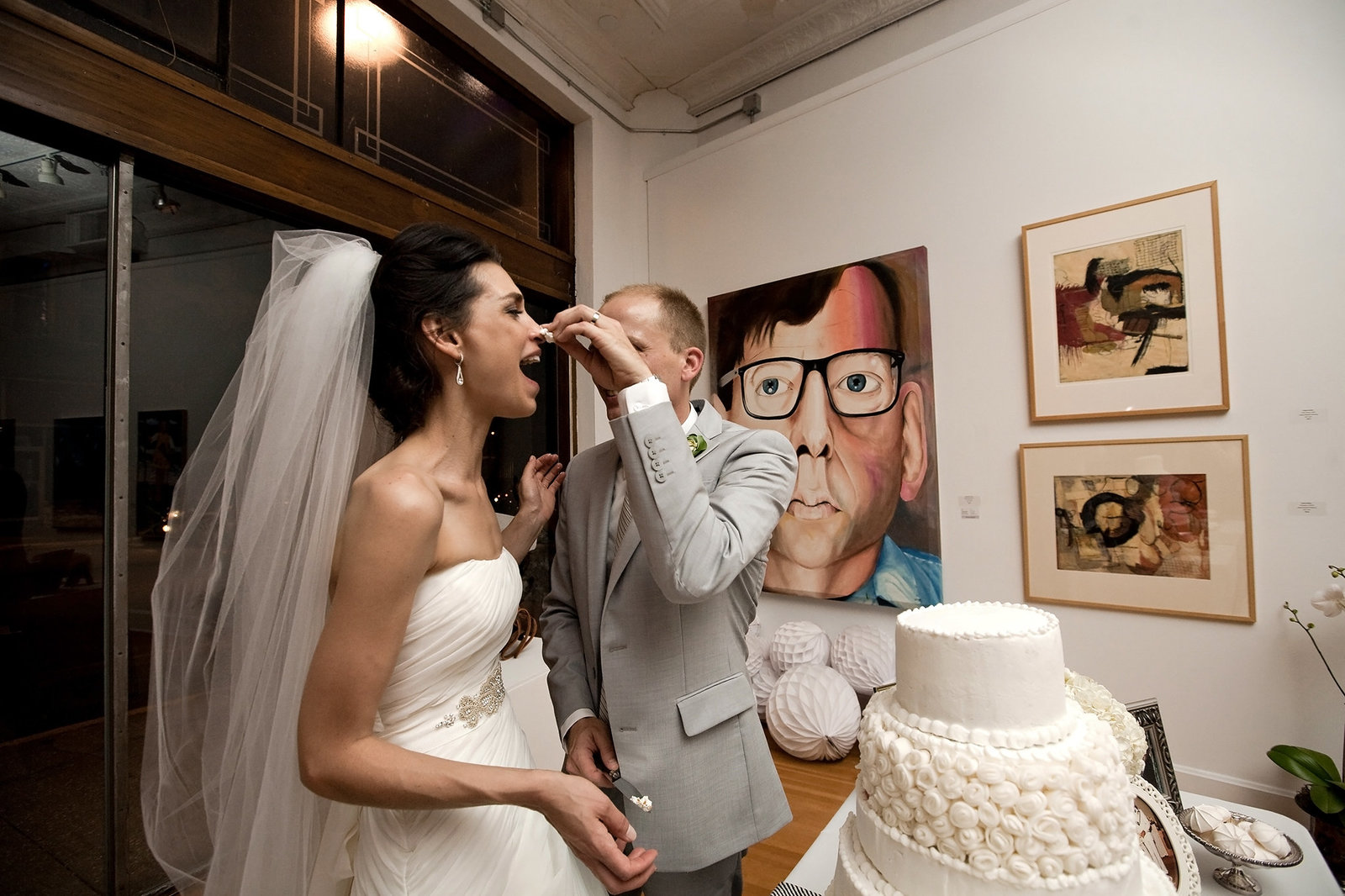 Couple cuts the cake at their Jacoby Arts Center wedding in Alton IL