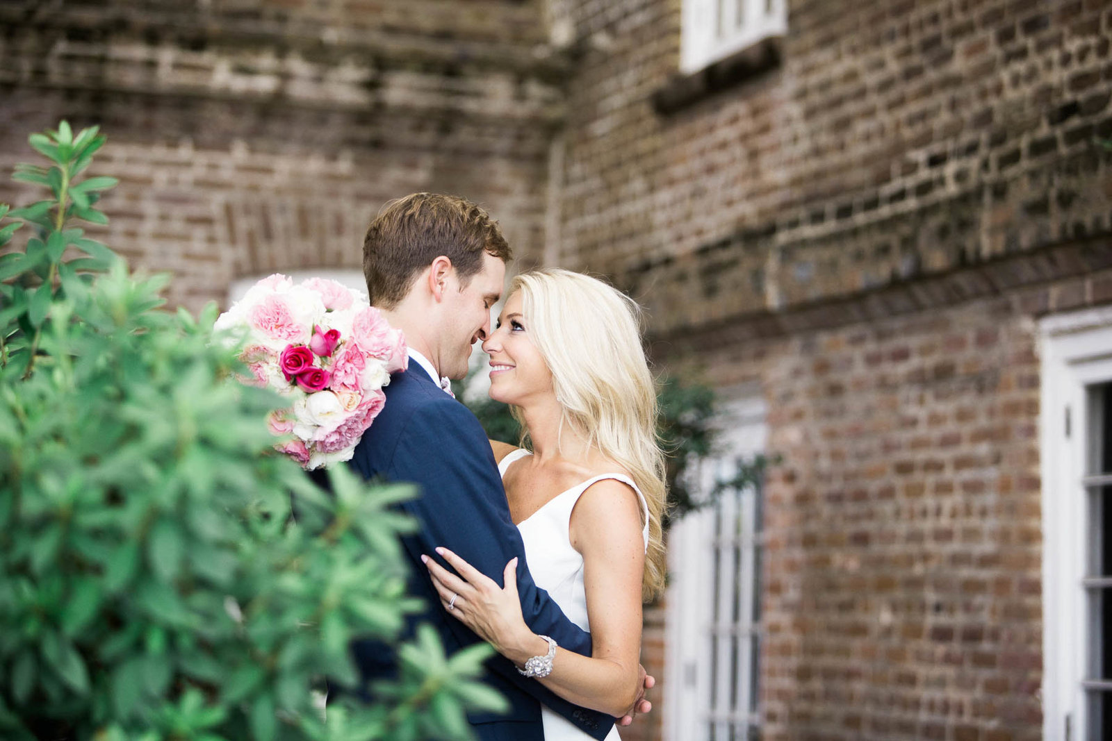 Bride and groom snuggle at the Rice Mill Building, Charleston, South Carolina