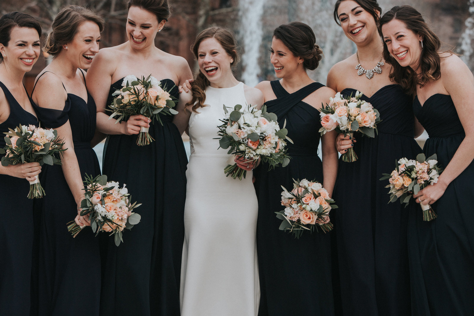 fun bride and bridesmaids portrait in philadelphia