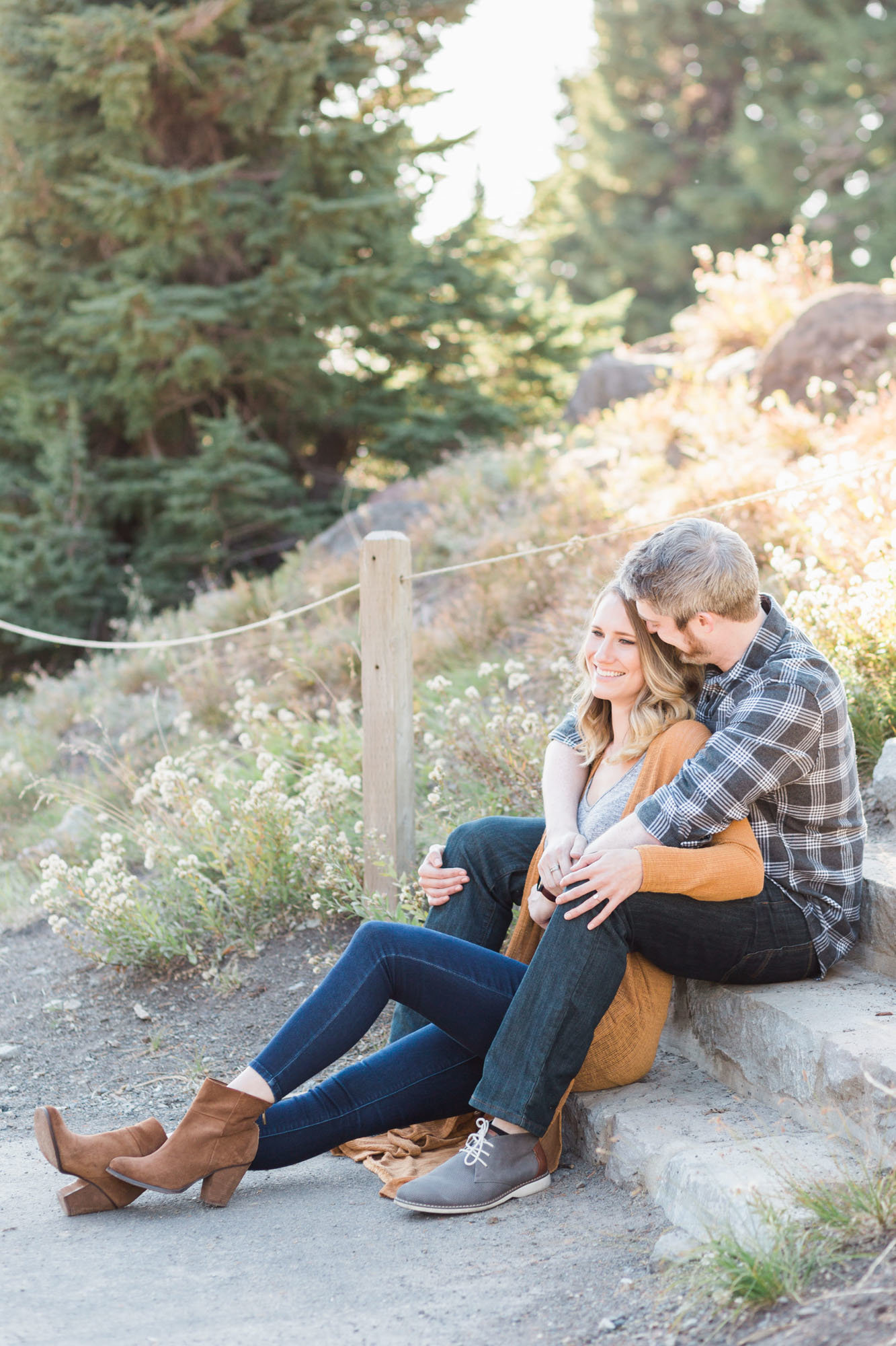 Couple sits on steps during engagement photo session