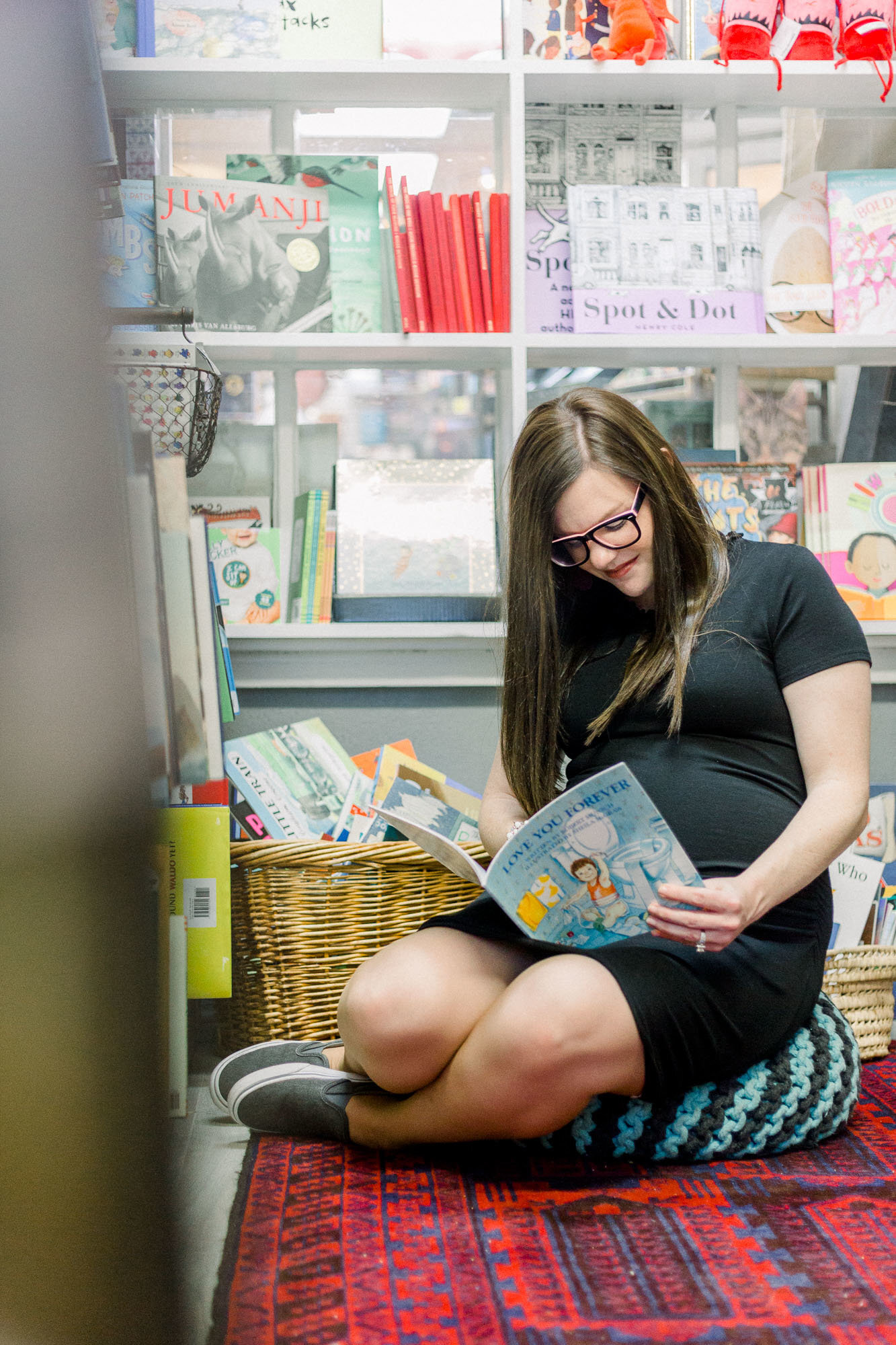 Maternity book store session captured by Staci Addison Photography