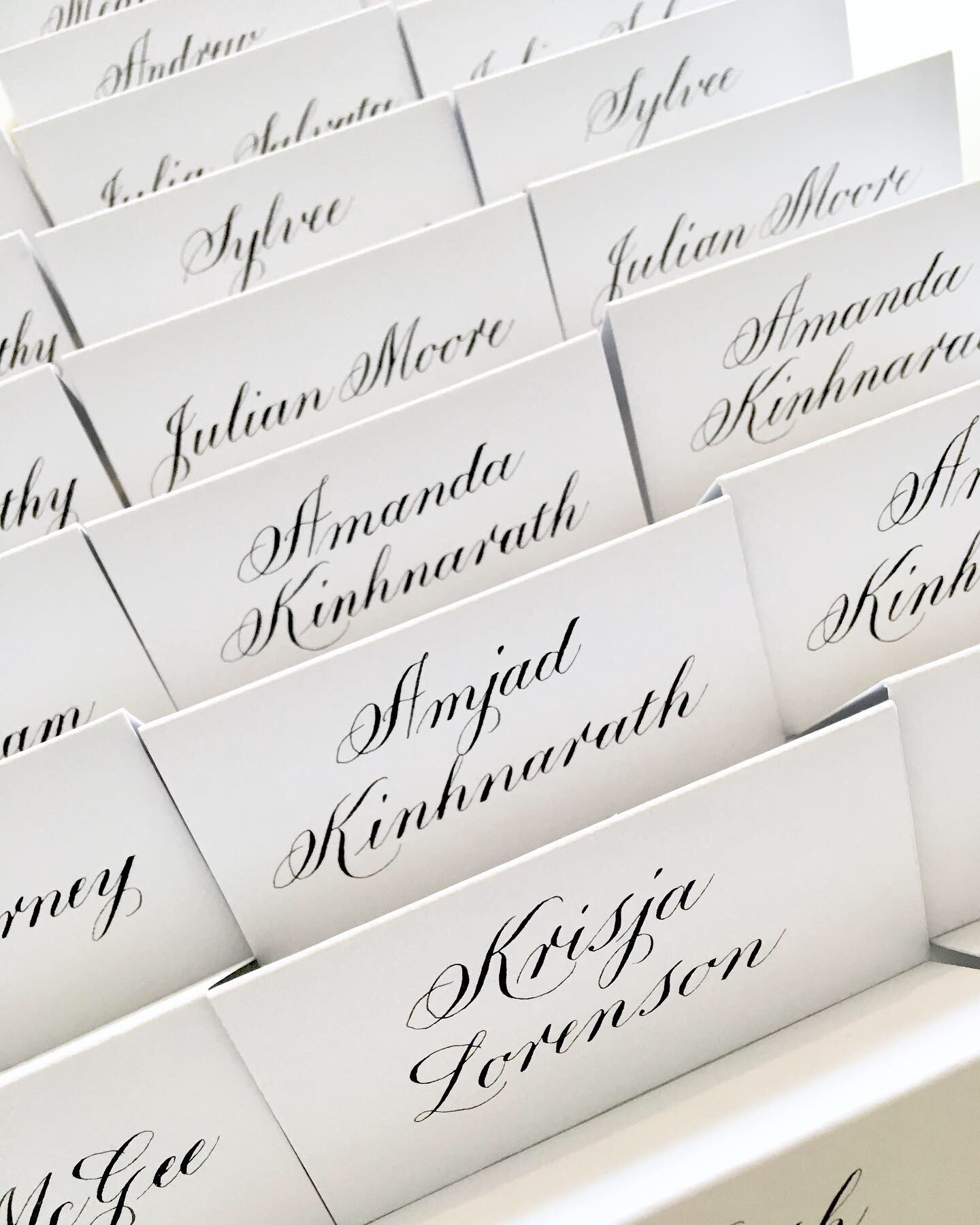Black ink Copperplate calligraphy on white place cards