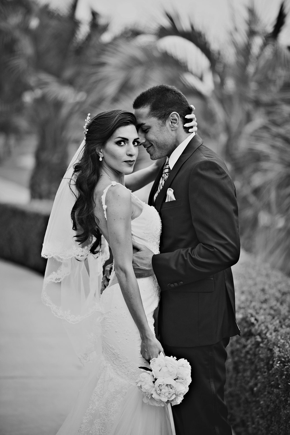 Striking black and white wedding portrait of a Persian Bride and Groom