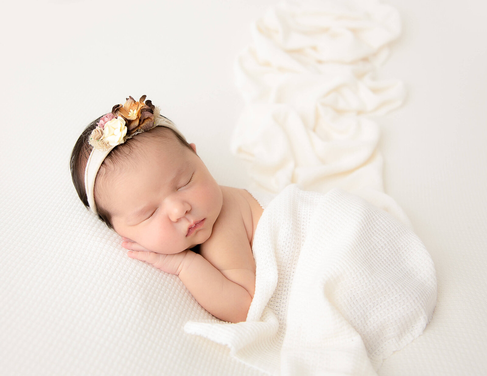 Sleeping newborn girl in our Rochester NY studio.