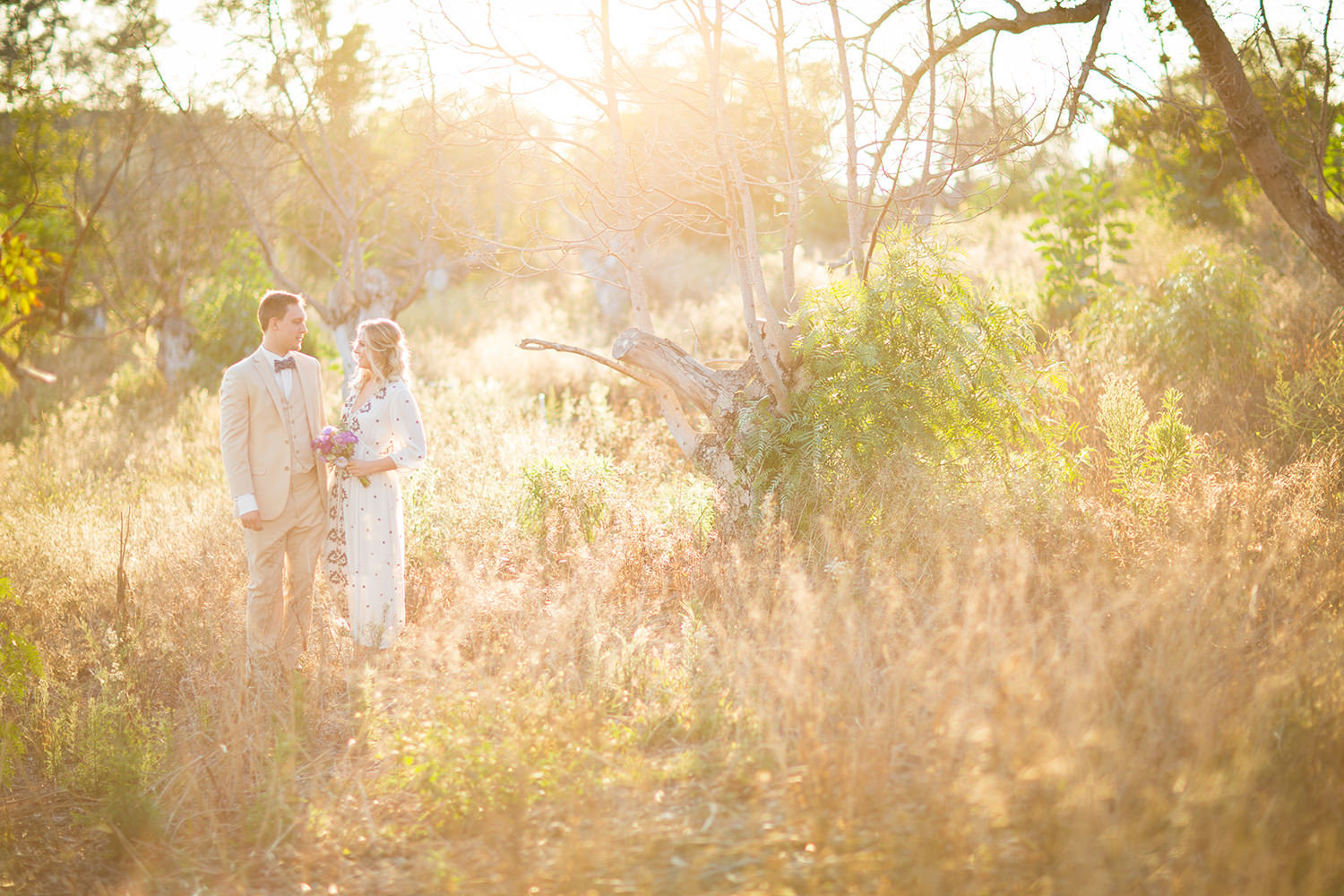 amazing light with bride and groom in open field