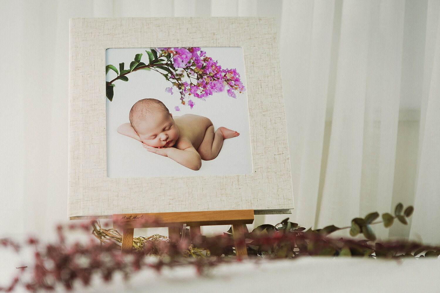 Product example of flushmount album featuring professional newborn photography