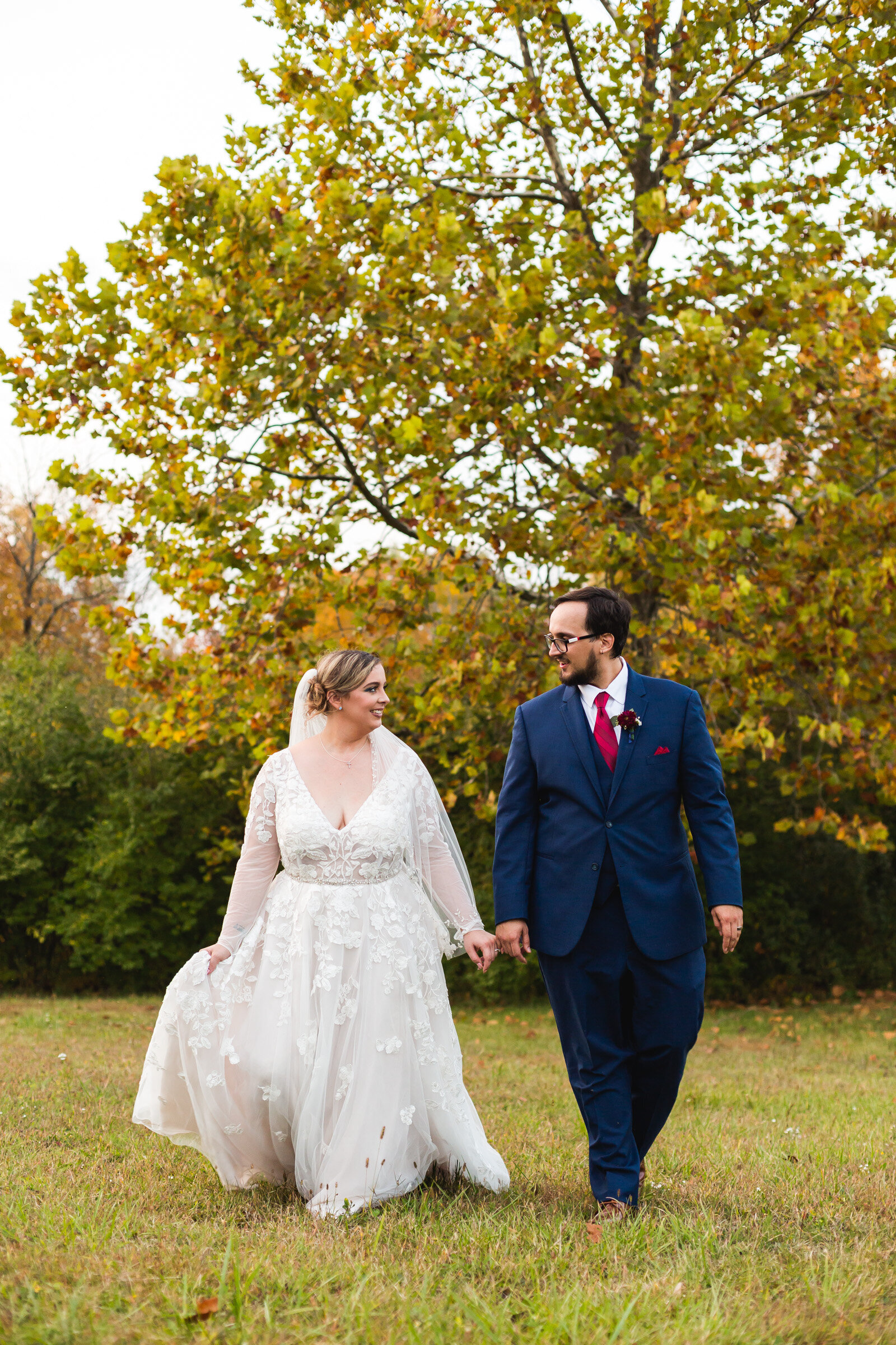 bride and groom walking at fall wedding in ohio