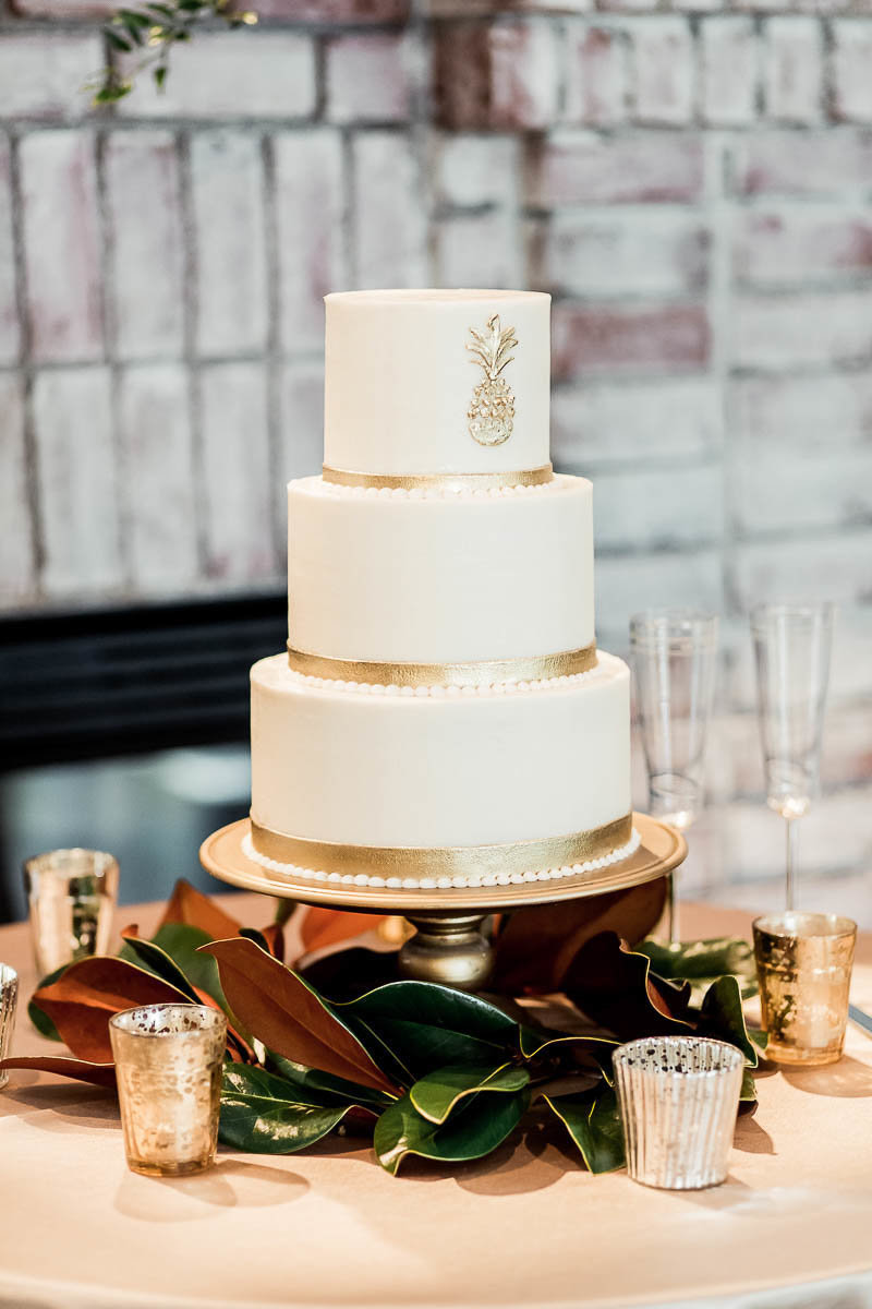 A gold and white cake is accented with a pineapple, Coleman Hall, Mt Pleasant, South Carolina