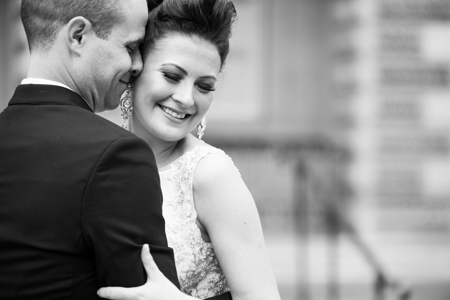 Black and white photo of bride and groom at Osgoode Hall