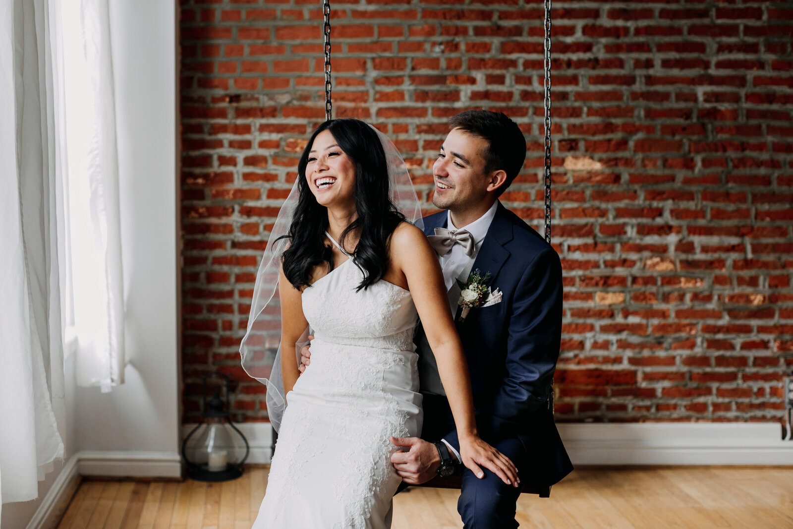 bride and groom with vintage brick wall