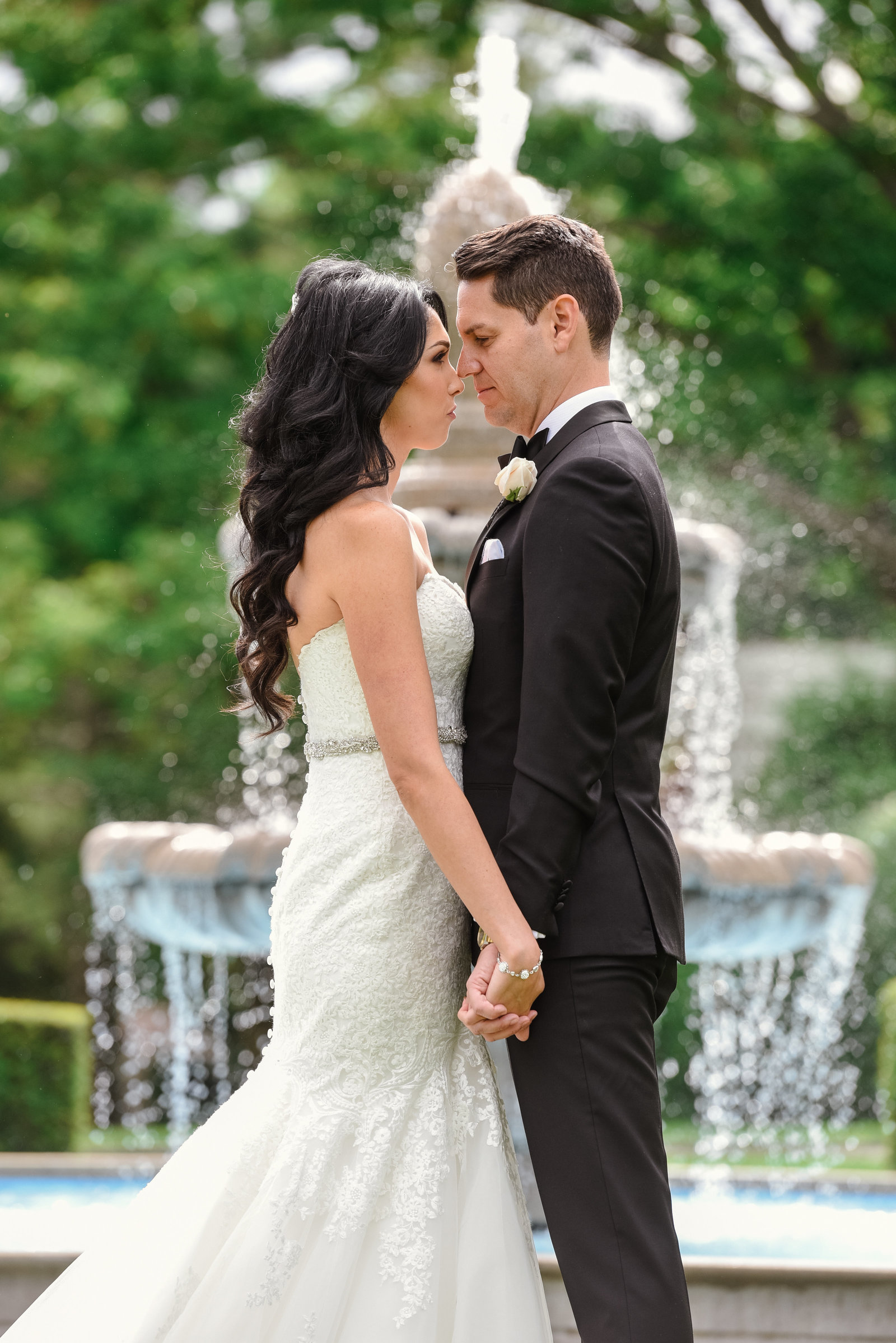 Bride and groom at the fountain of Glen Cove Mansion